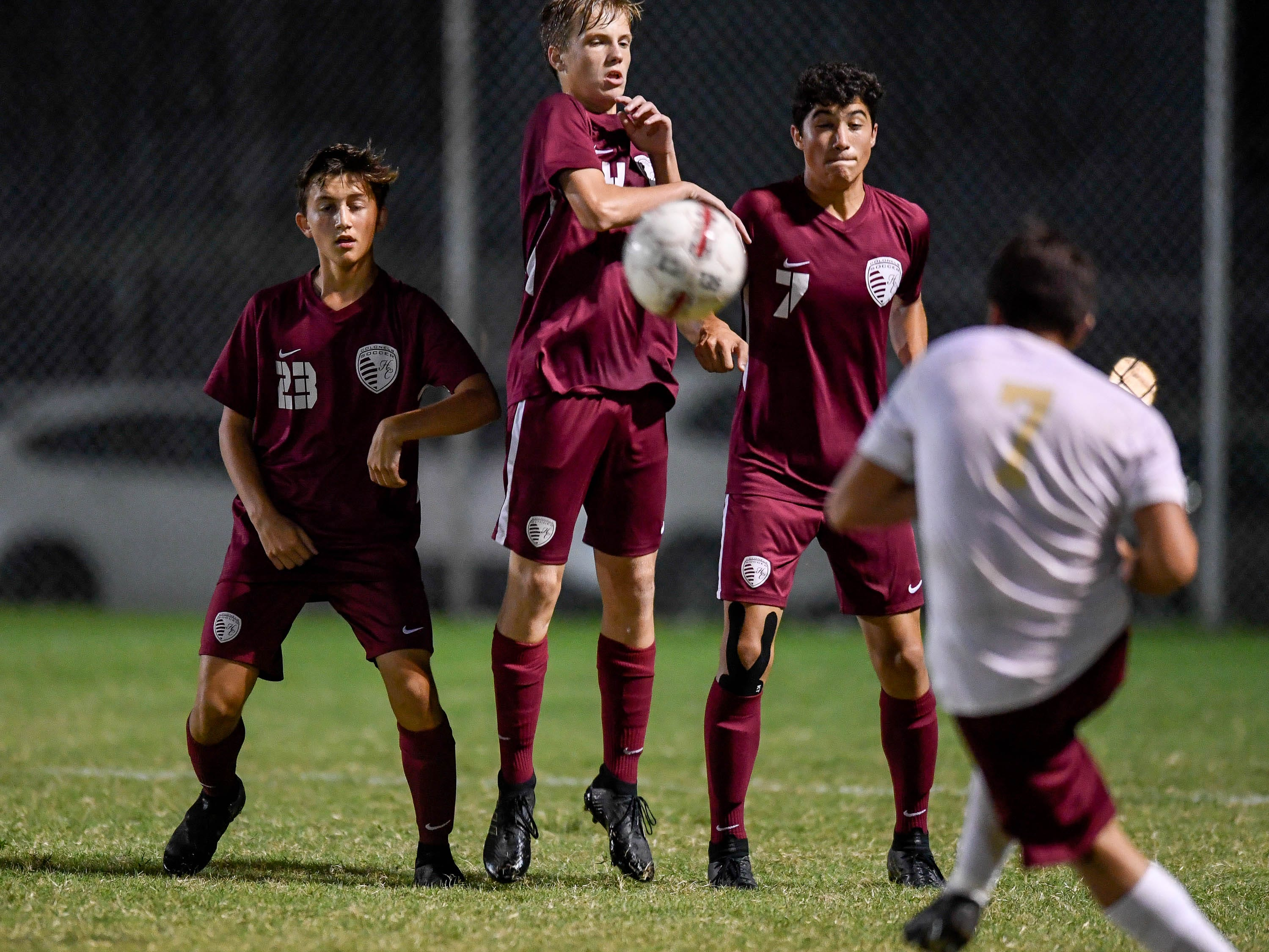 Henderson County's Wes Tompkins (23), Trevor Book (24) and  Adam Gillham (7) block a goal kick from as the Henderson County Colonels play the Webster County Trojans in the Sixth District Soccer Tournament at Colonel Field Wednesday, October 10, 2018.