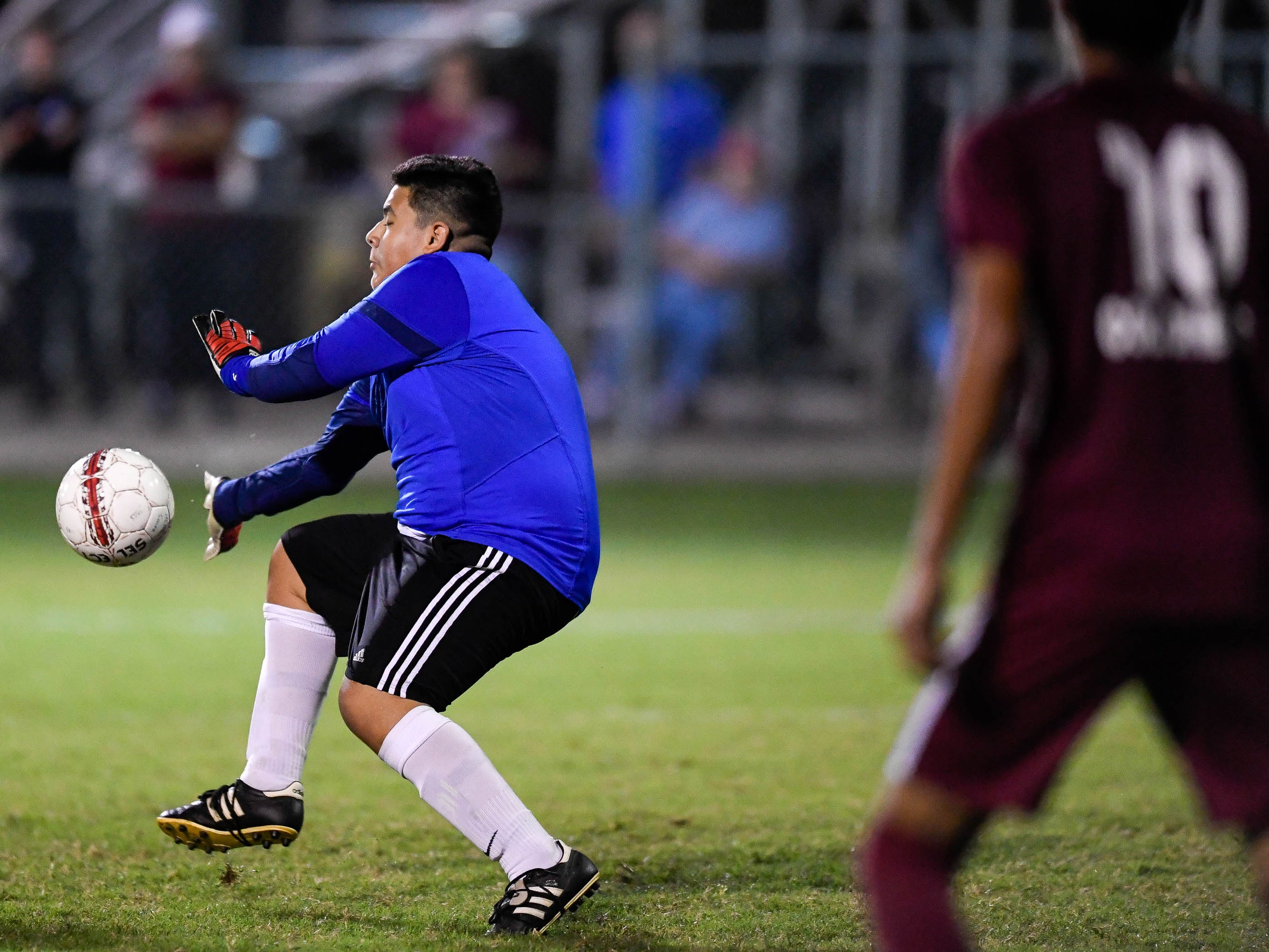 Webster goalie Jorge Torres (14) blocks a shot on goal as the Henderson County Colonels play the Webster County Trojans in the Sixth District Soccer Tournament at Colonel Field Wednesday, October 10, 2018.
