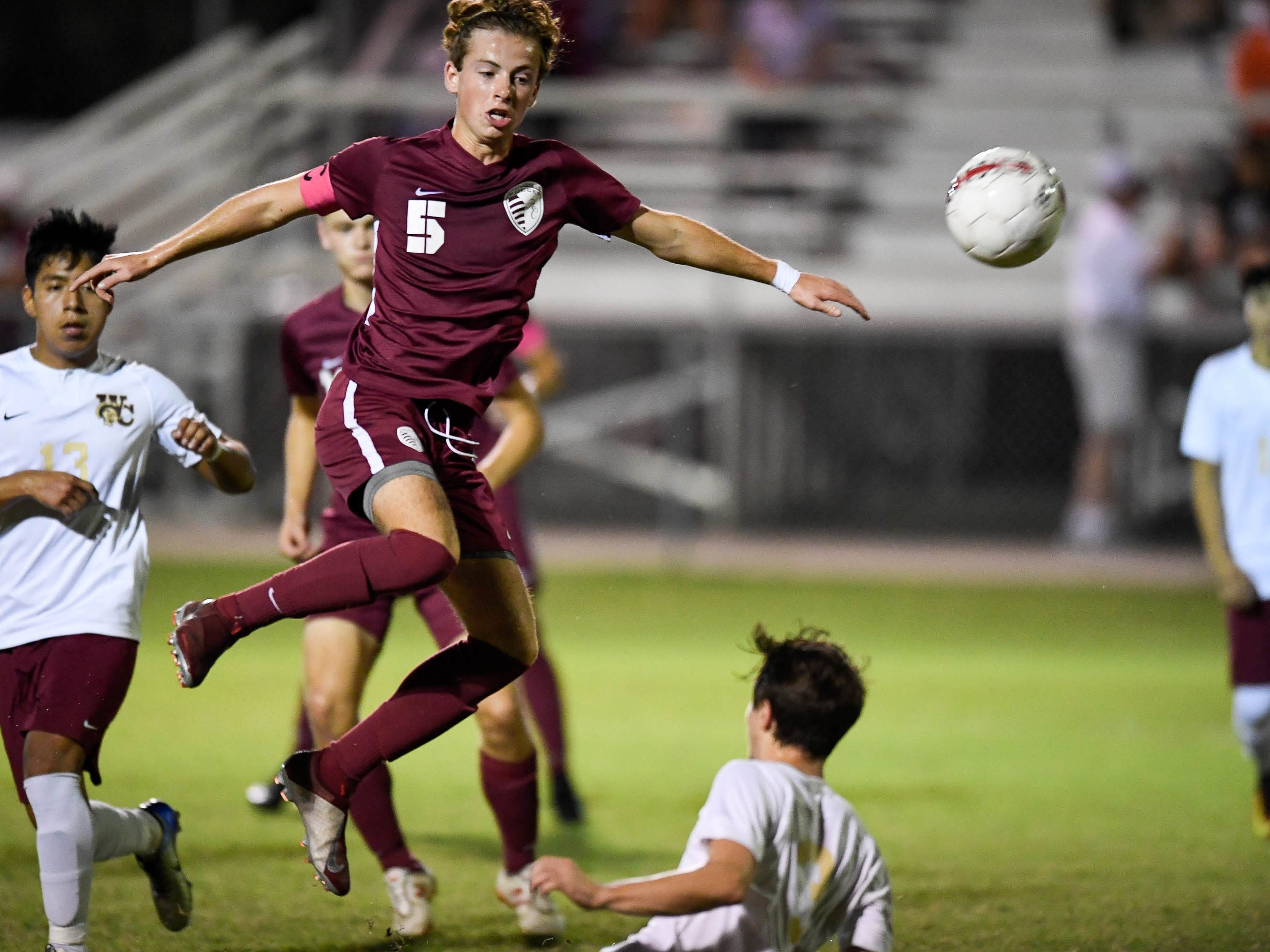 Henderson County's Cale Wright (5) with the ball following a corner kick in front of the Webster goal as the Henderson County Colonels play the Webster County Trojans in the Sixth District Soccer Tournament at Colonel Field Wednesday, October 10, 2018.