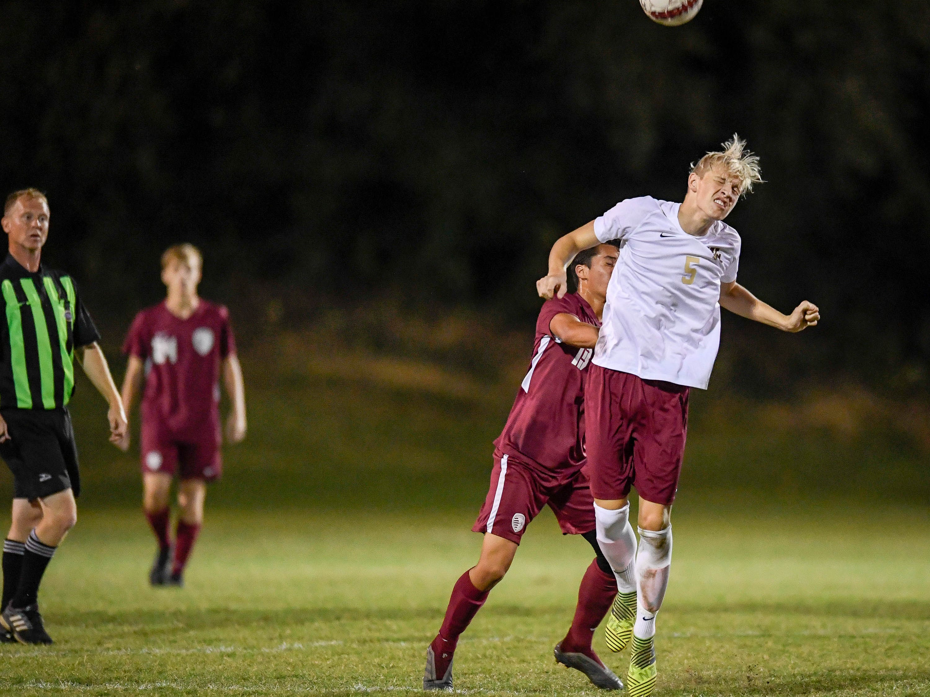 Webster's Dawson McVay (5) heads the ball as the Henderson County Colonels play the Webster County Trojans in the Sixth District Soccer Tournament at Colonel Field Wednesday, October 10, 2018.