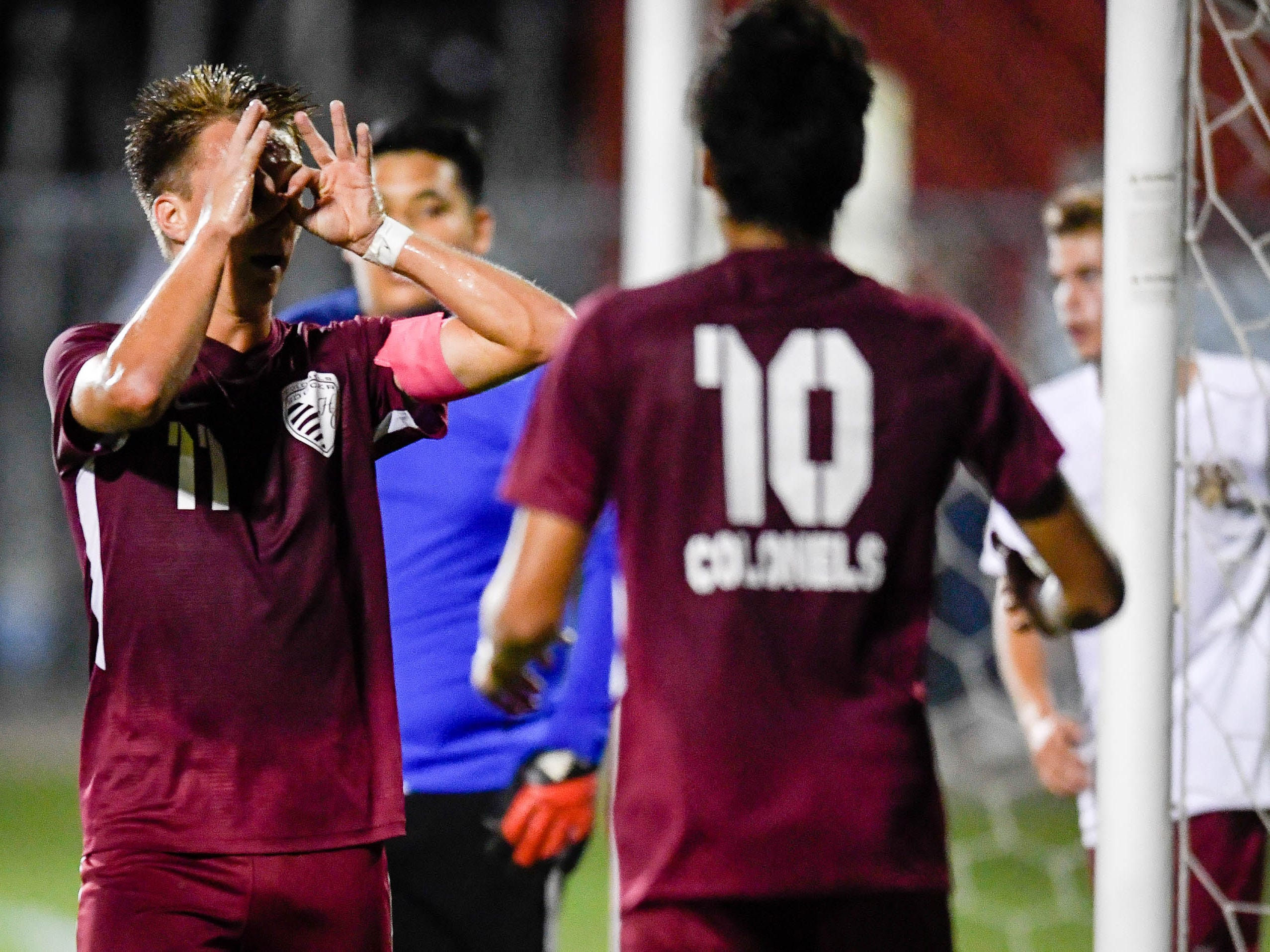 Henderson County's Max Wawrin (11) celebrates a goal as the Henderson County Colonels play the Webster County Trojans in the Sixth District Soccer Tournament at Colonel Field Wednesday, October 10, 2018.