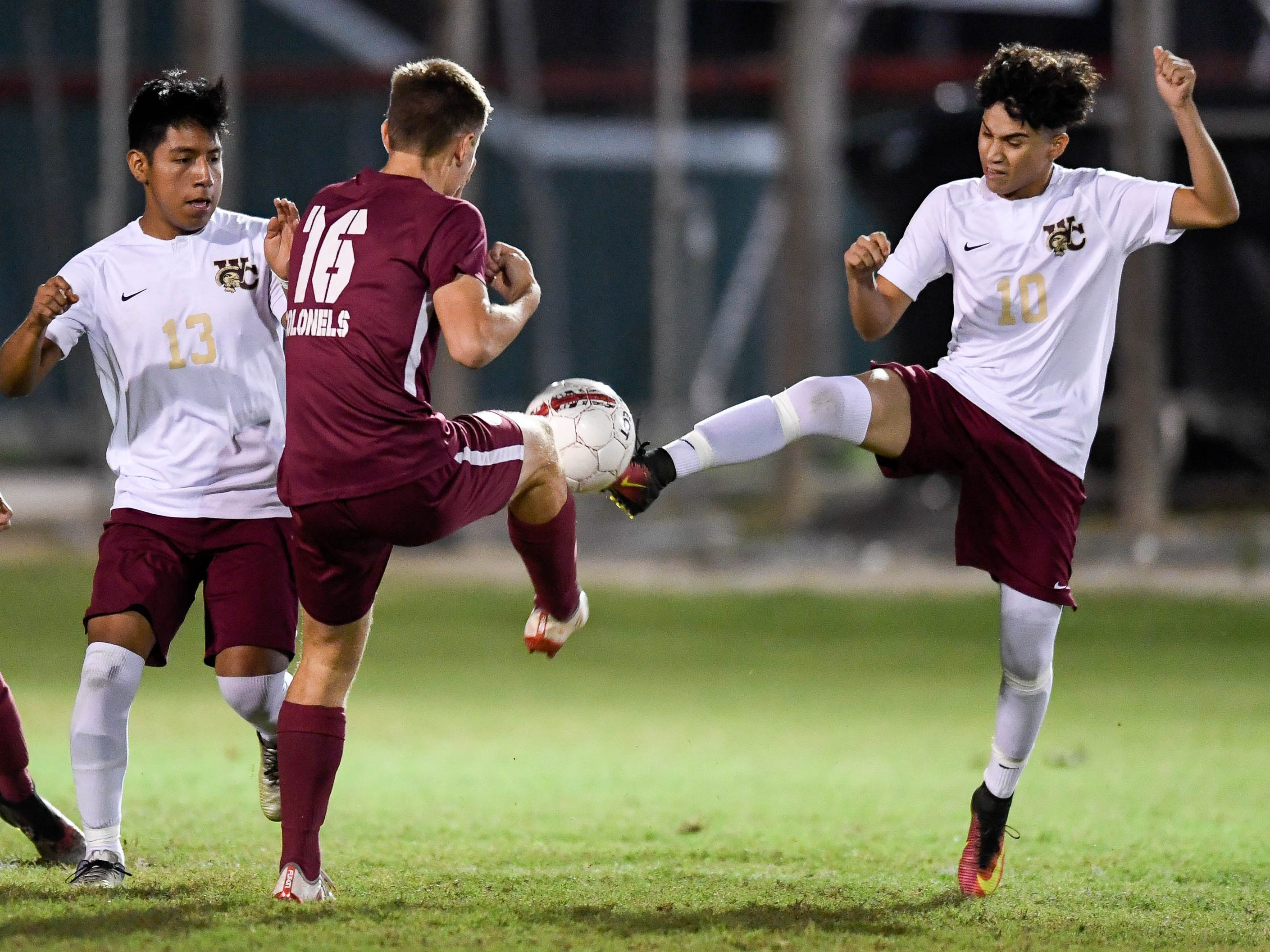 Henderson County's Lucas Butler (16) and Webster's Santos Portillo (10) battle for control of the ball as the Henderson County Colonels play the Webster County Trojans in the Sixth District Soccer Tournament at Colonel Field Wednesday, October 10, 2018.