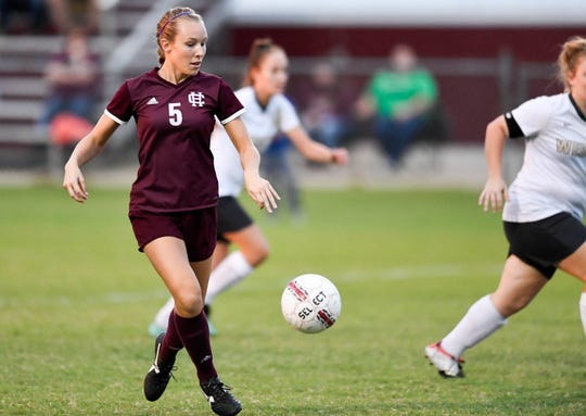 Henderson's Maddie Griggs (5) brings the ball down field as the Henderson County Lady Colonels play the Webster County Lady Trojans in the Sixth District Soccer Tournament at Colonel Field Wednesdayt, October 10, 2018.