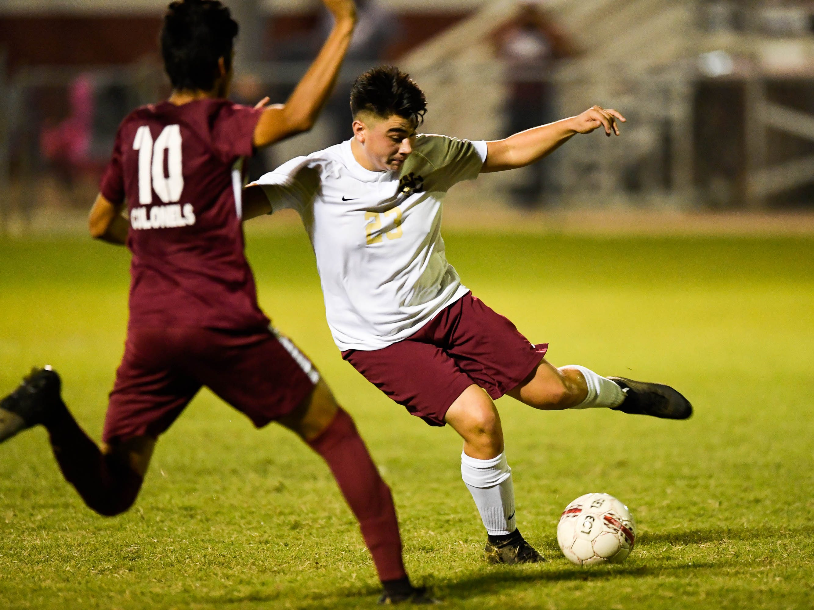 Henderson County's David Gonzalez (10) and Webster's Henry Portillo (23) in action as the Henderson County Colonels play the Webster County Trojans in the Sixth District Soccer Tournament at Colonel Field Wednesday, October 10, 2018.