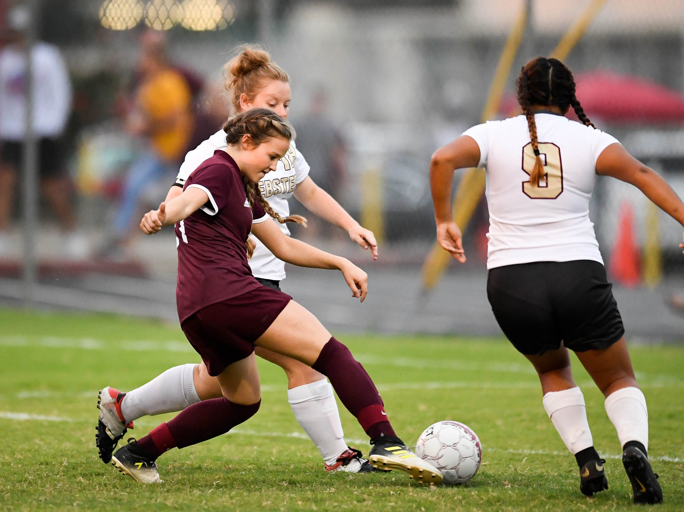 Henderson's Cecilla Palummo (21) drives against Webster's Madelyn Hackney (18) as the Henderson County Lady Colonels play the Webster County Lady Trojans in the Sixth District Soccer Tournament at Colonel Field Wednesdayt, October 10, 2018.