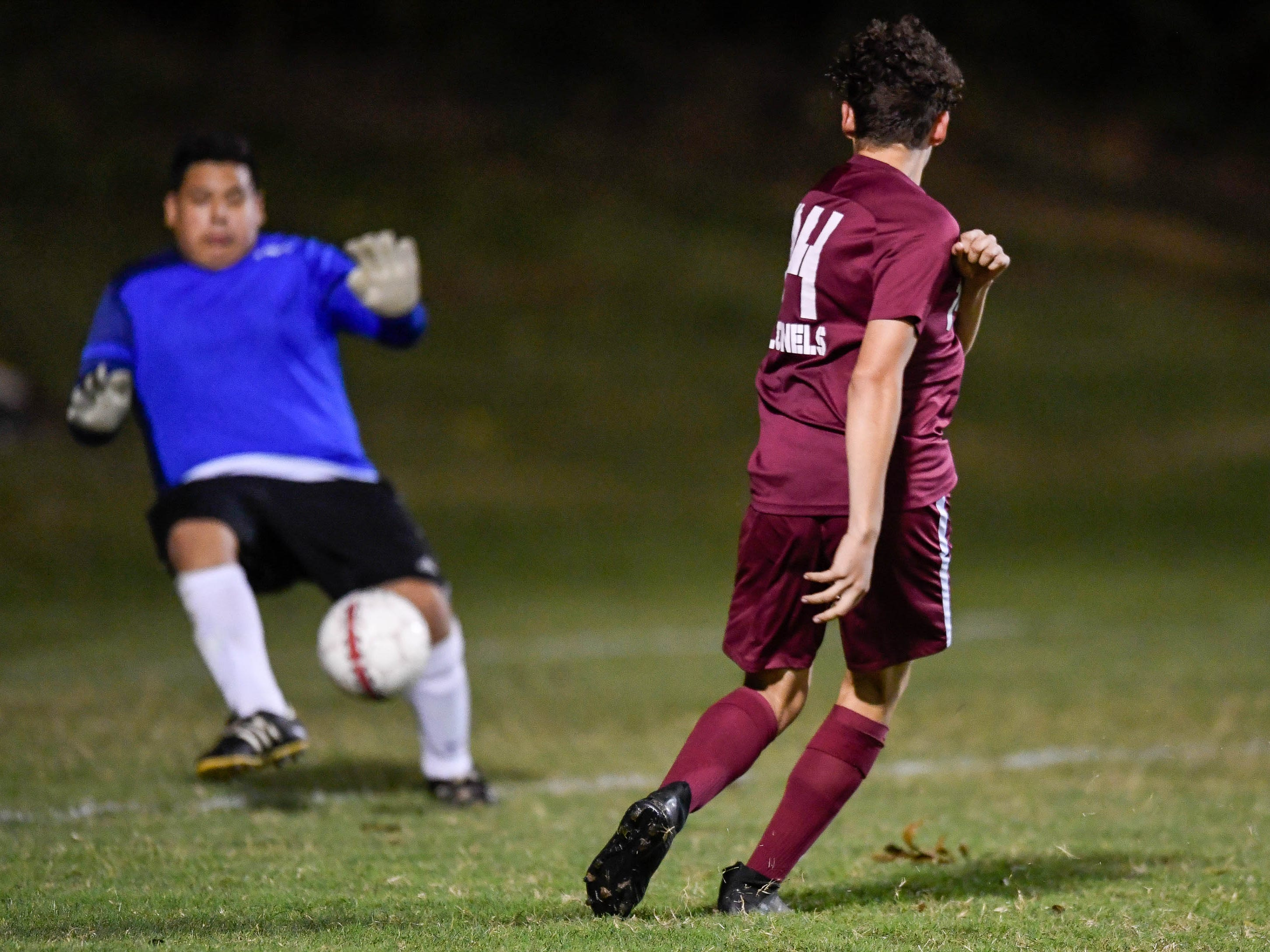 Henderson County's Jordan Toribio (14) makes a goal shot as the Henderson County Colonels play the Webster County Trojans in the Sixth District Soccer Tournament at Colonel Field Wednesday, October 10, 2018.