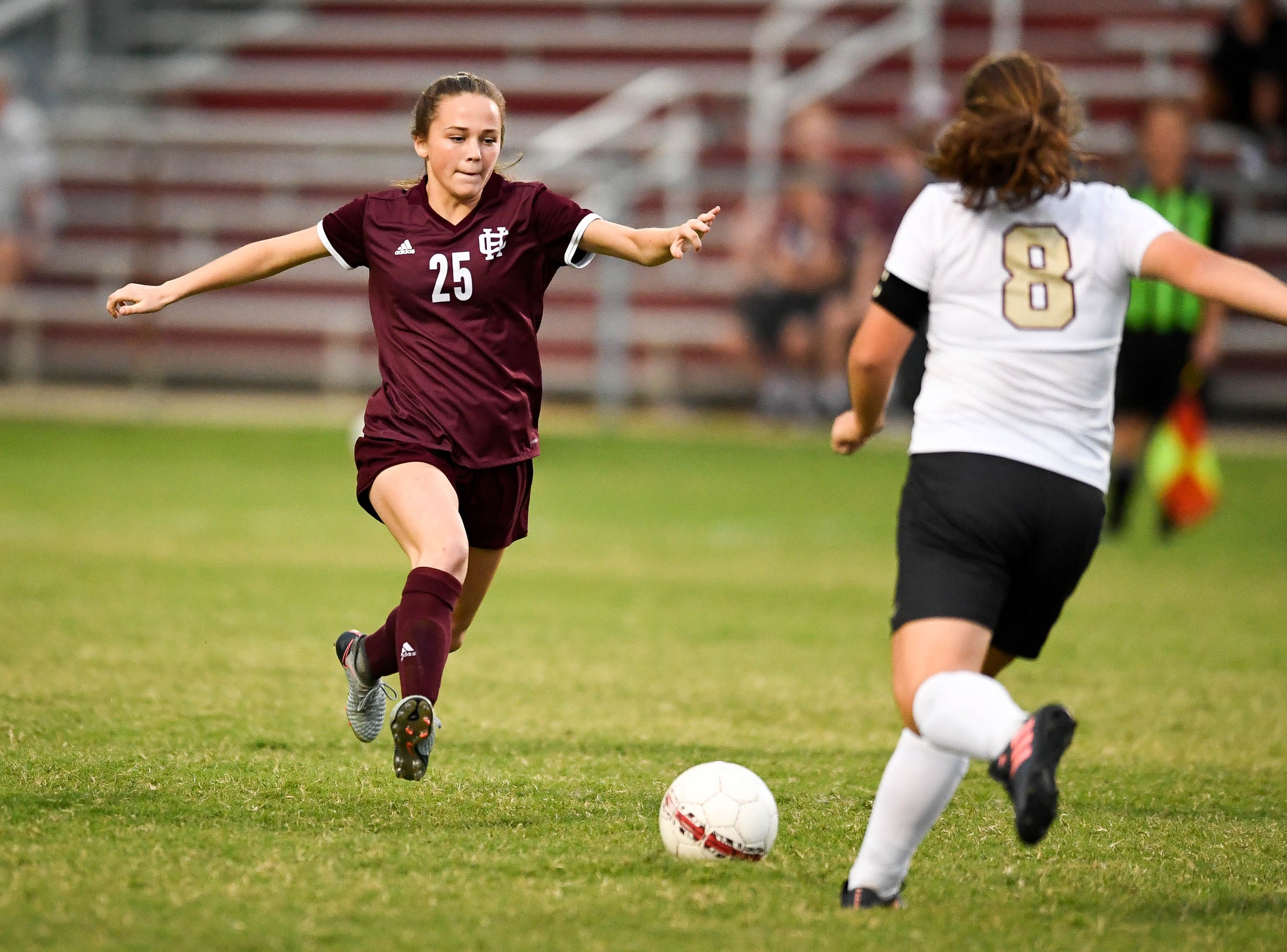 Henderson's Kate Reusch (25) and Webster's Olivia Utley (8) race to the ball as the Henderson County Lady Colonels play the Webster County Lady Trojans in the Sixth District Soccer Tournament at Colonel Field Wednesdayt, October 10, 2018.