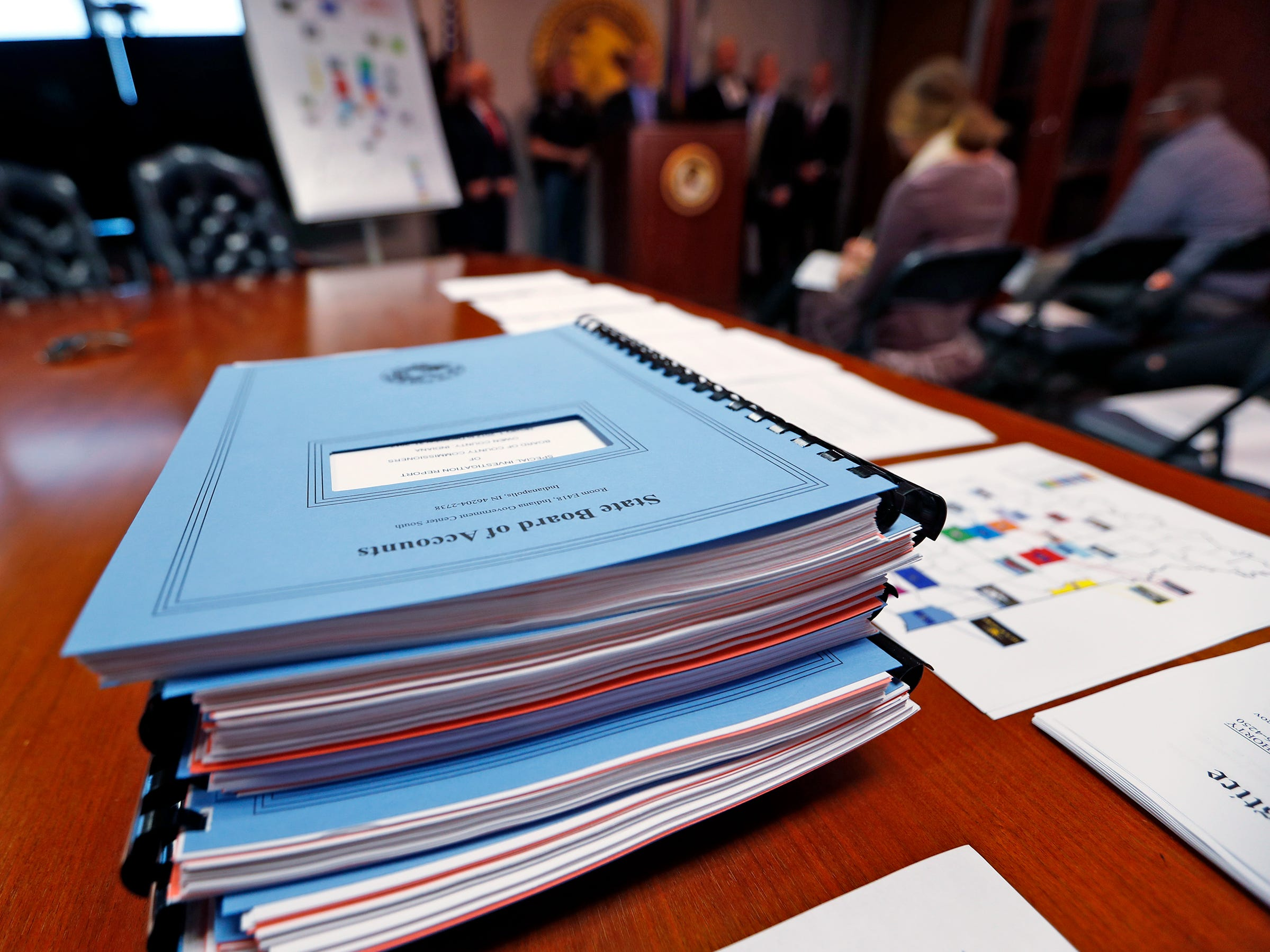 "State Board of Accounts booklets are seen during a press conference at the U.S. Attorney's office, Thursday, Oct. 11, 2018.  U.S. Attorney Josh Minkler, the FBI, Indiana State Police, and the State Board of Accounts release details about joint operation in a crackdown involving ""state-wide corruption,"" from Operation Public Accountability."