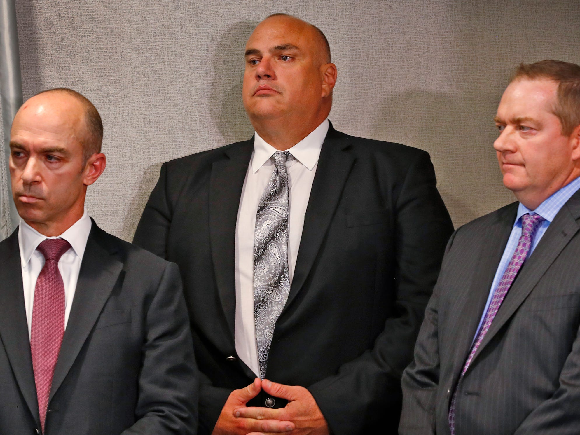 "FBI Special Agent in Charge Grant Mendenhall, from left, Indiana State Board of Accounts State Examiner Paul Joyce, and Deputy Executive Director of the Indiana Prosecuting Attorney's Council Chris Naylor listen during a press conference at the U.S. Attorney's office, Thursday, Oct. 11, 2018.  U.S. Attorney Minkler, the FBI, Indiana State Police, and the State Board of Accounts release details about joint operation in a crackdown involving ""state-wide corruption,"" from Operation Public Accountability."