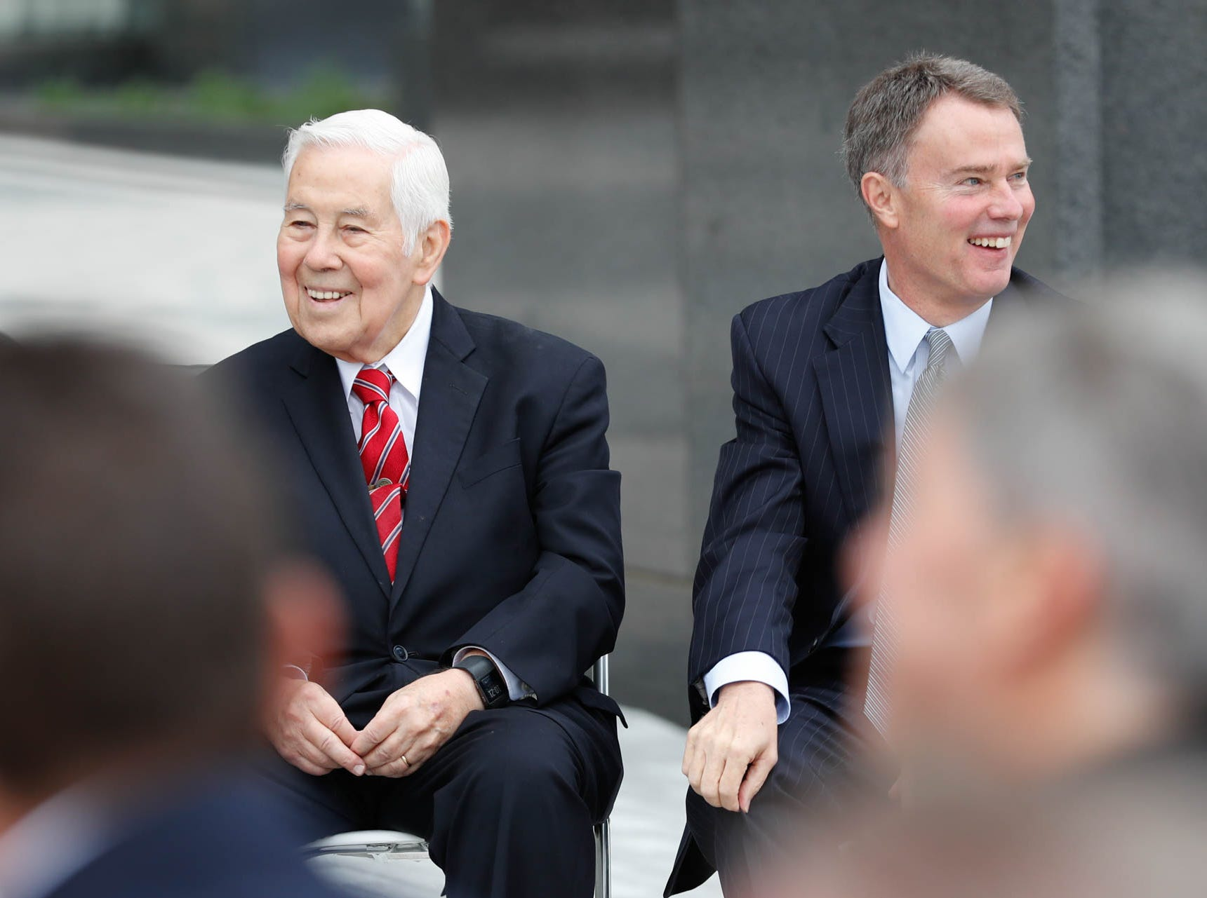 Former Senator and Mayor, Richard Lugar, and the current Mayor of Indianapolis, Joe Hogsett, listen to remarks during the reopening and dedication of Richard G. Lugar Plaza at the City-County Building in Indianapolis on Thursday, Oct. 11, 2018.