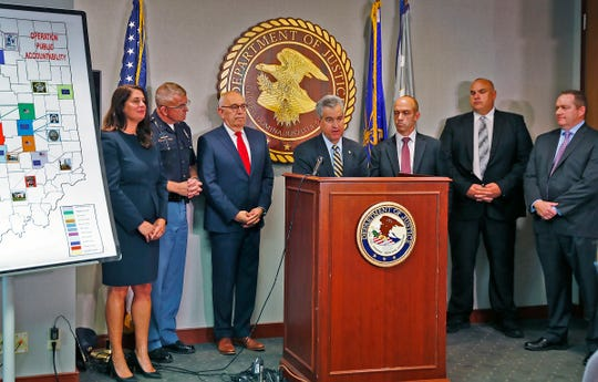 U.S. Attorney for the Southern District of Indiana Josh Minkler, center, speaks during a press conference at the U.S. Attorney's office, Thursday, Oct. 11, 2018.