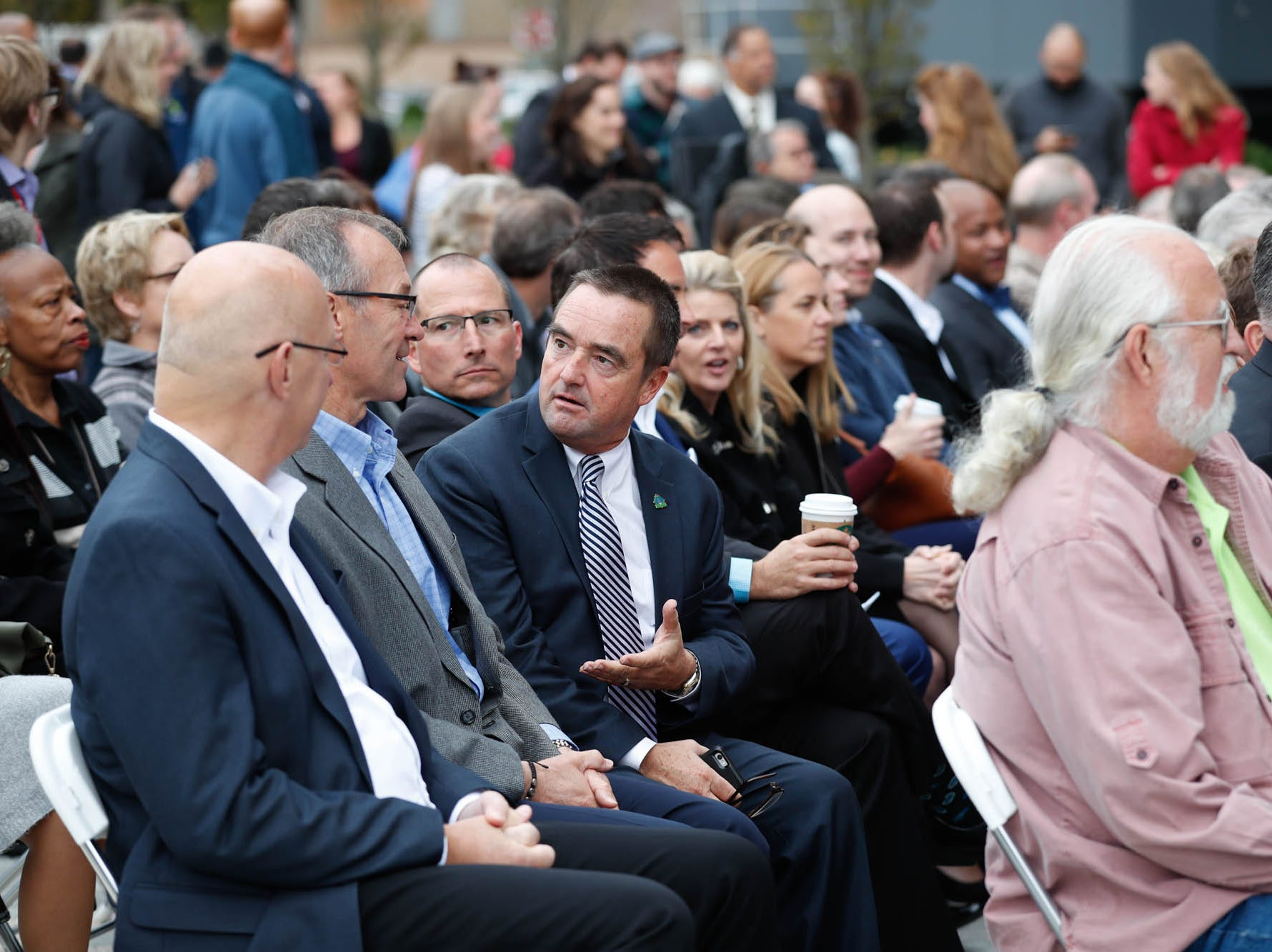 Guests attend the reopening and dedication of Richard G. Lugar Plaza at the City-County Building in Indianapolis on Thursday, Oct. 11, 2018.