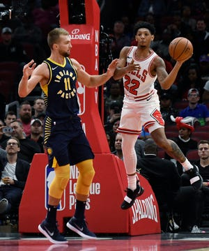 Chicago Bulls' Cameron Payne (22) looks to pass the ball as Indiana Pacers' Domantas Sabonis (11) defends during the first half of an NBA preseason basketball game Wednesday, Oct. 10, 2018, in Chicago.