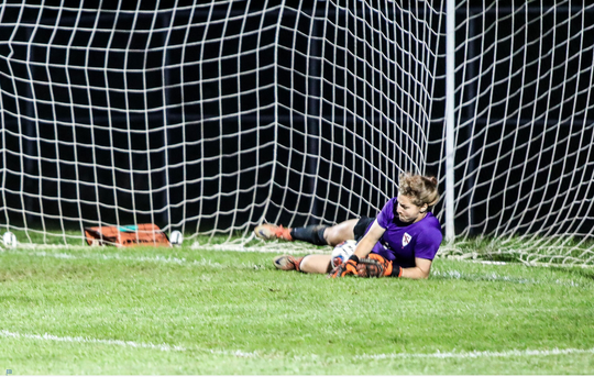 Fishers goalie Kaitlyn Hicks gathers a saved penalty kick against Noblesville in last week's sectional final.