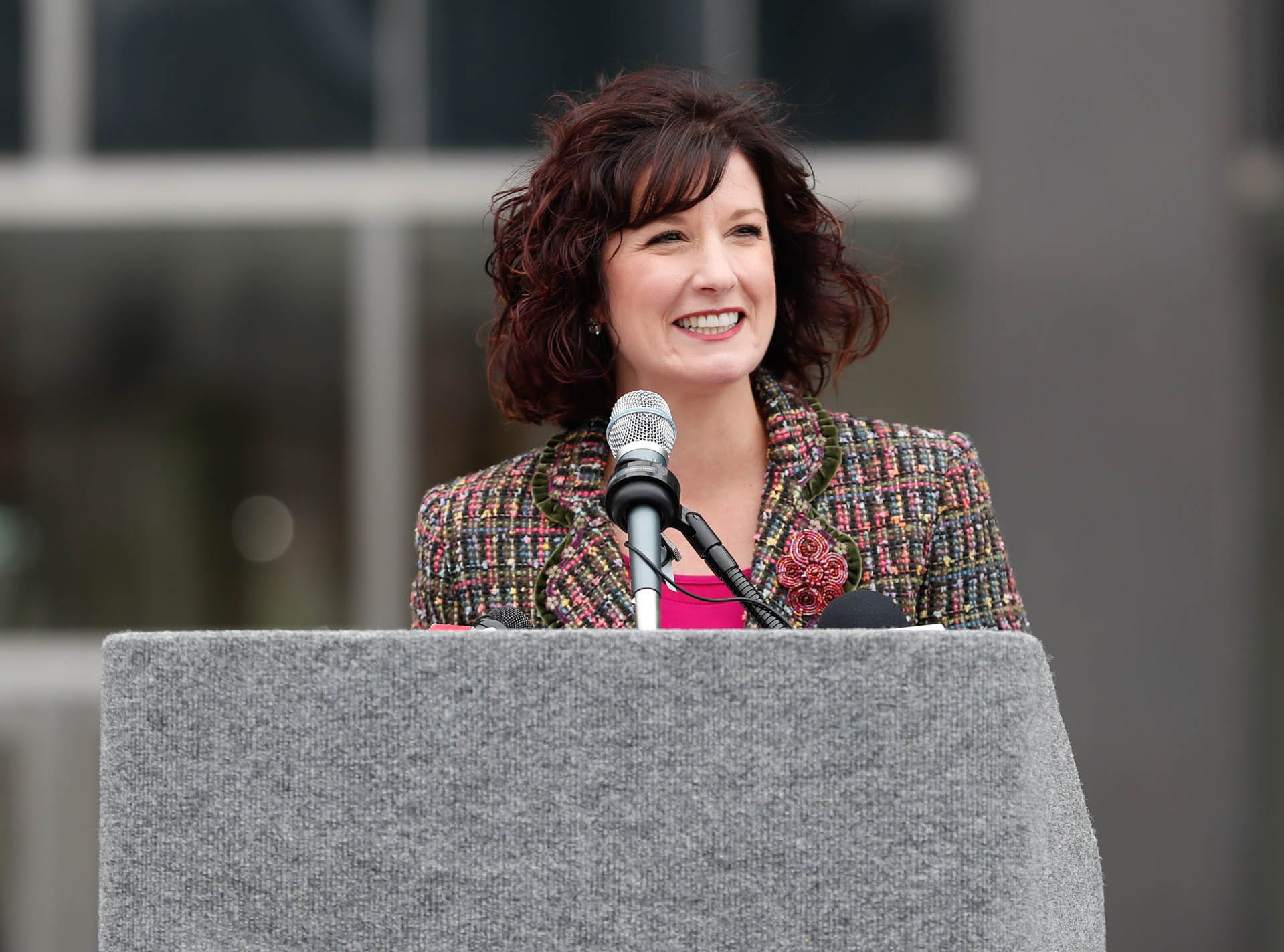 Director of the Department of Metropolitan Development, ​Emily Mack, gives remarks during the reopening and dedication of Richard G. Lugar Plaza at the City-County Building in Indianapolis on Thursday, Oct. 11, 2018.