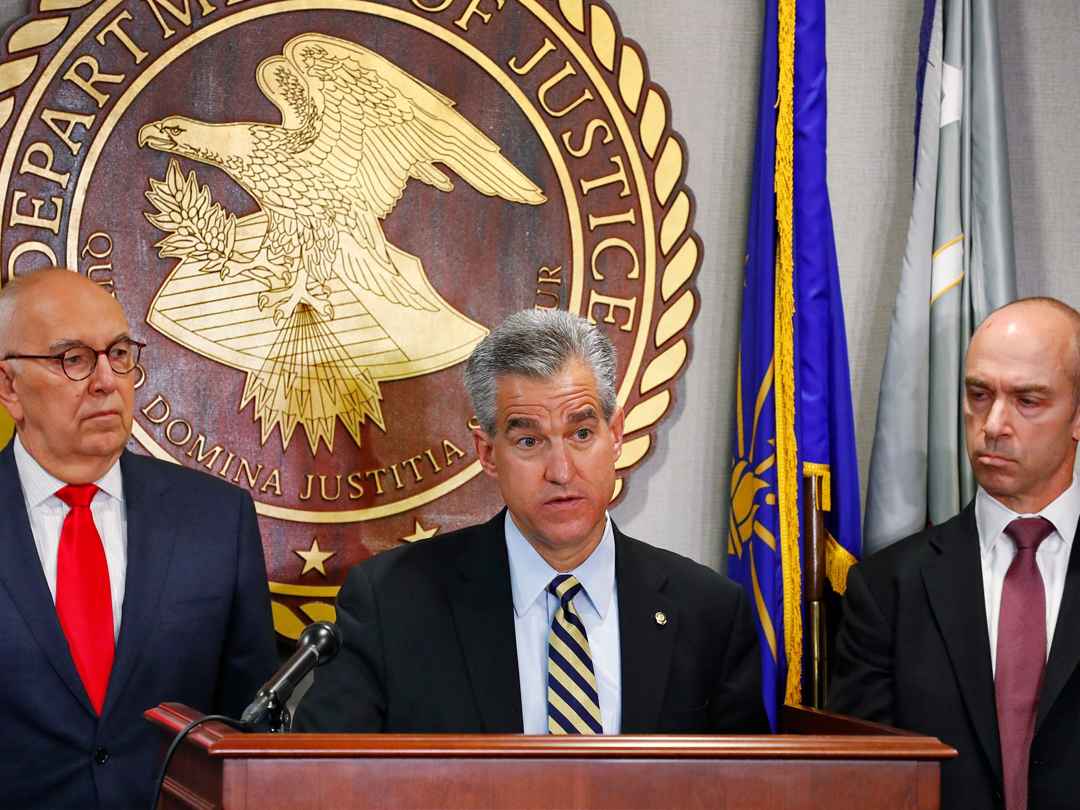 "U.S. Attorney for the Southern District of Indiana Josh Minkler, center, flanked by Marion County Prosecutor Terry Curry, left, and FBI Special Agent in Charge Grant Mendenhall, right, speaks during a press conference at the U.S. Attorney's office, Thursday, Oct. 11, 2018.  U.S. Attorney Minkler, the FBI, Indiana State Police, and the State Board of Accounts release details about joint operation in a crackdown involving ""state-wide corruption,"" from Operation Public Accountability."