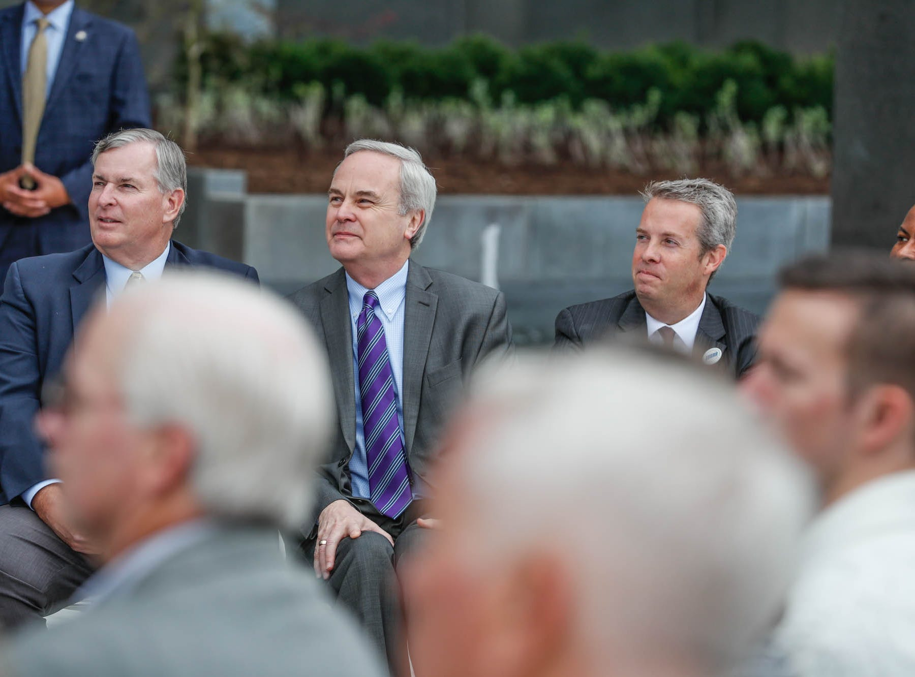 Guests listen to remarks during the reopening and dedication of Richard G. Lugar Plaza at the City-County Building in Indianapolis on Thursday, Oct. 11, 2018.
