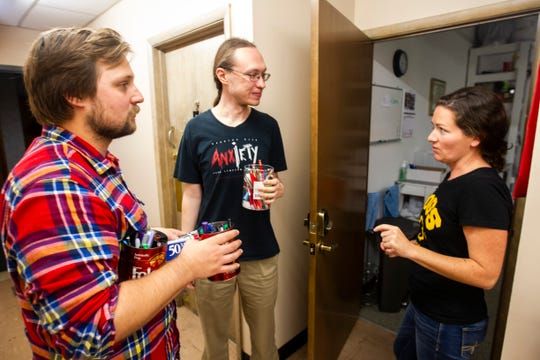 Caleb Klipowicz and Kenneth Elliott talk with Laura Szech after a Campaign to Organize Graduate Students meeting Wednesday, Oct. 10, 2018, at the Wesley Center, in Iowa City. COGS was originally organized by graduated student employees at the University of Iowa in the spring of 1993.