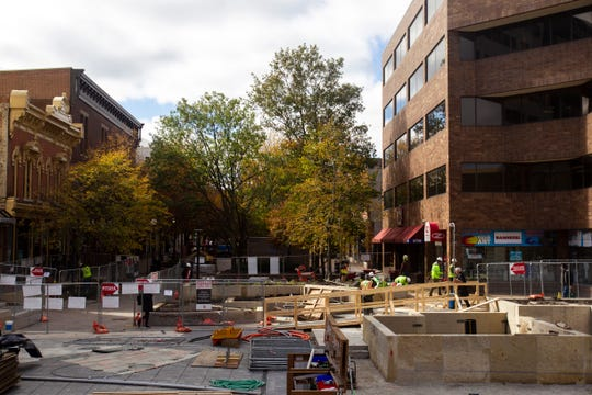 Construction continues on updates to the pedestrian mall on Thursday afternoon, Oct. 11, 2018, in downtown Iowa City.