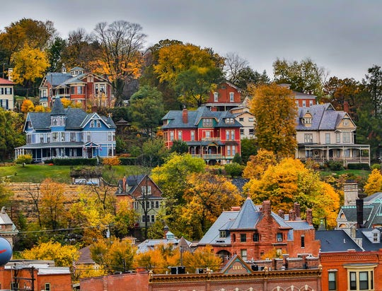 Leaves were said to be turning this week along the river near Dubuque, but whether they will look as spectacular as this file photo of historic homes on the bluff remains a question.  Timing the peak leaf-viewing period can be a challenge, especially during this fall's unusually heavy rains