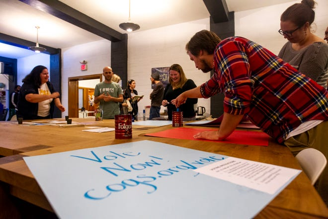 Caleb Klipowicz, originally from Fort Mill, South Carolina, grabs a marker while making a get out the vote sign after a Campaign to Organize Graduate Students meeting Wednesday, Oct. 10, 2018, at the Wesley Center, in Iowa City. Klipowicz is a graduate student in the anthropology department and works with COGS on Labor and Solidarity.