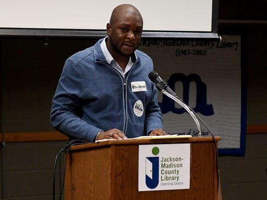 Madison County Democratic Chairman Byron Elam gives announcement pertaining to the party during their monthly meeting, Thursday, October 11, at the Jackson-Madison County Library.