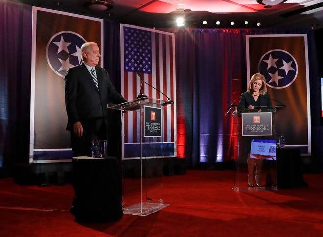 Democratic candidate and former Gov. Phil Bredesen, left, and Republican U.S. Rep. Marsha Blackburn wait for the start of the Tennessee U.S. Senate debate at The University of Tennessee, Wednesday, Oct. 10, 2018, in in Knoxville, Tenn.