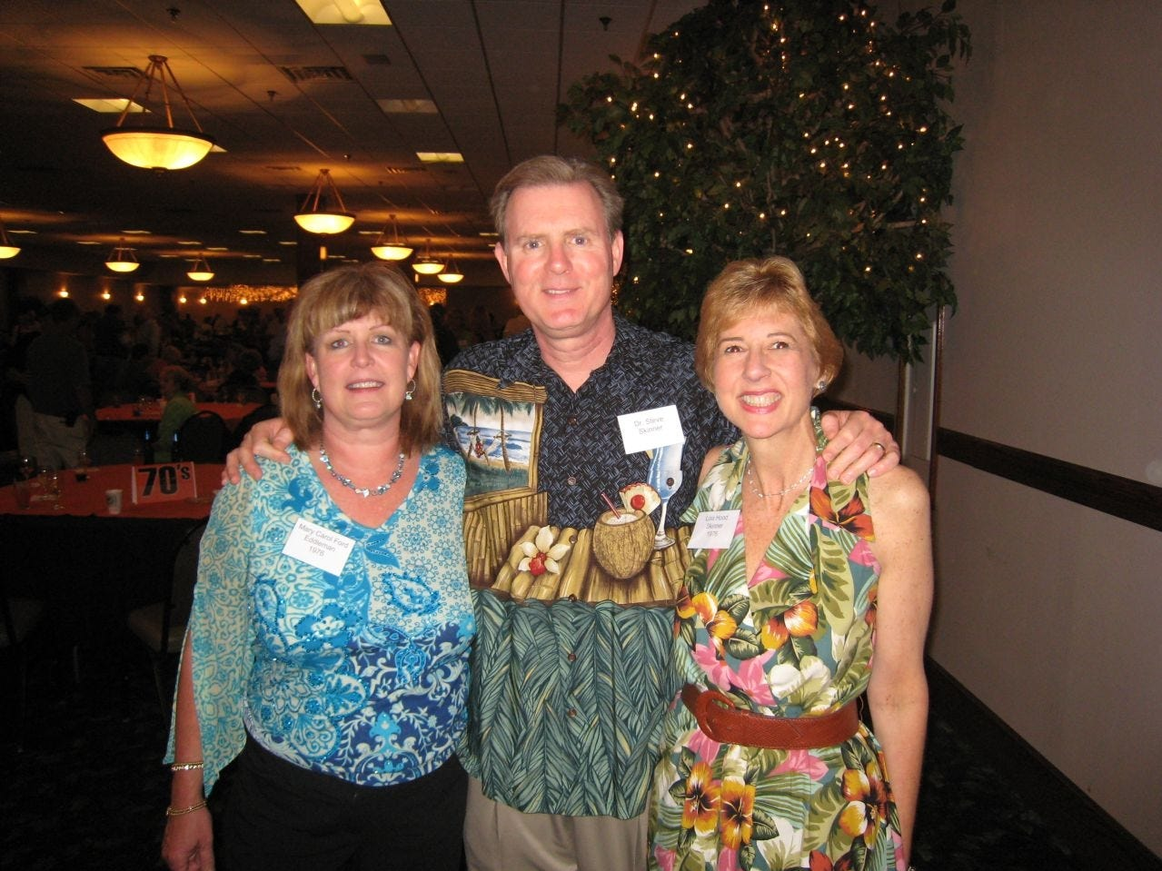 Lisa Hood Skinner, right, with her husband, Steve, and Mary Carol Ford Eddleman, her fellow classmate at Young High and later sorority sister at UT, enjoys a good time at the recent Big, Fat Young High Reunion.