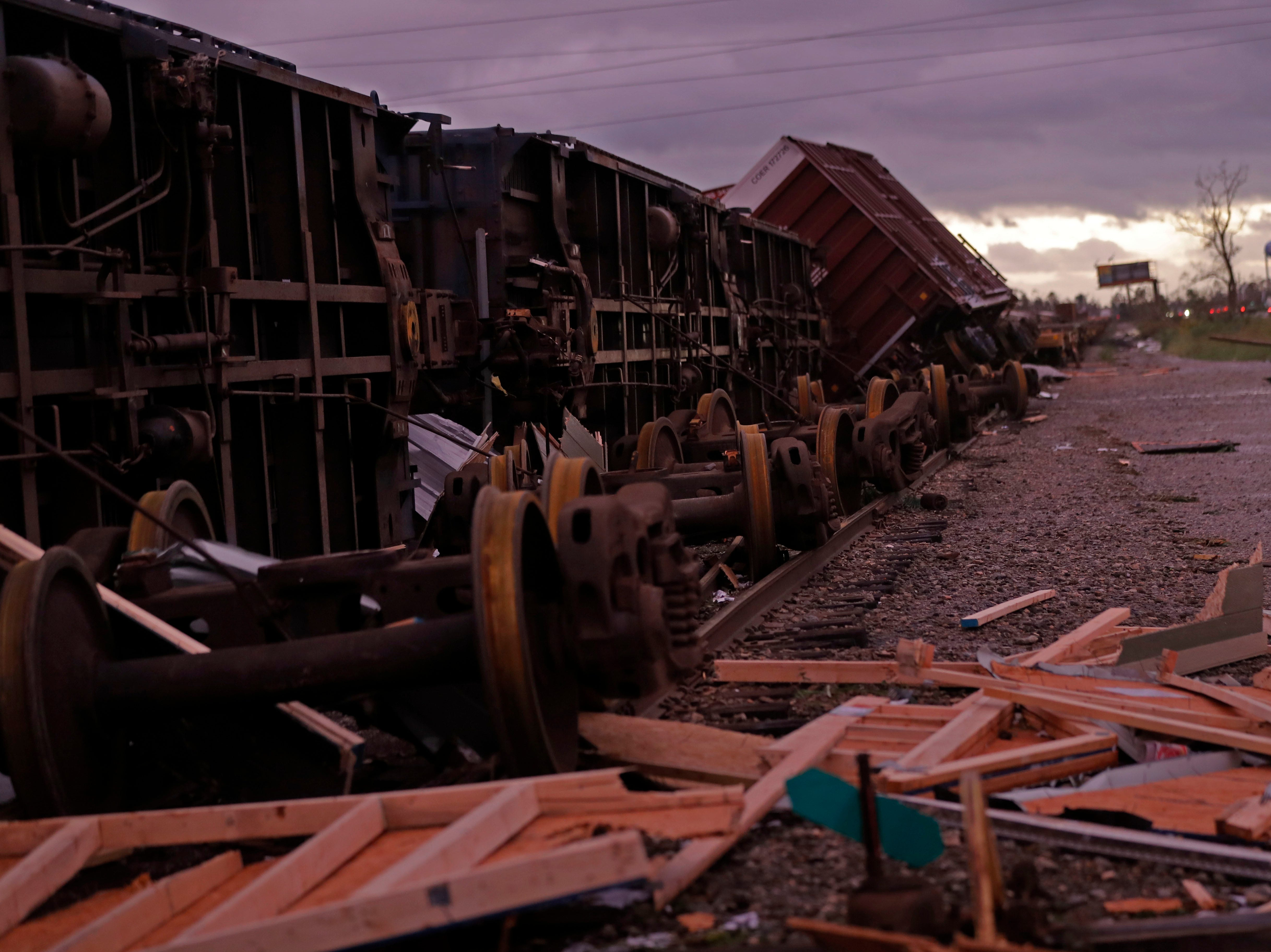 Derailed box cars are seen in the aftermath of Hurricane Michael in Panama City, Fla., Wednesday, Oct. 10, 2018.