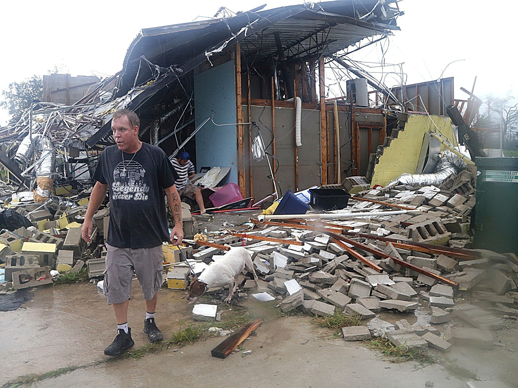 Brian Bon inspects damages in the Panama City downtown area after Hurricane Michael made landfall in Panama City, Fla., Wednesday, Oct. 10, 2018. Supercharged by abnormally warm waters in the Gulf of Mexico, Hurricane Michael slammed into the Florida Panhandle with terrifying winds of 155 mph Wednesday, splintering homes and submerging neighborhoods before continuing its march inland.
