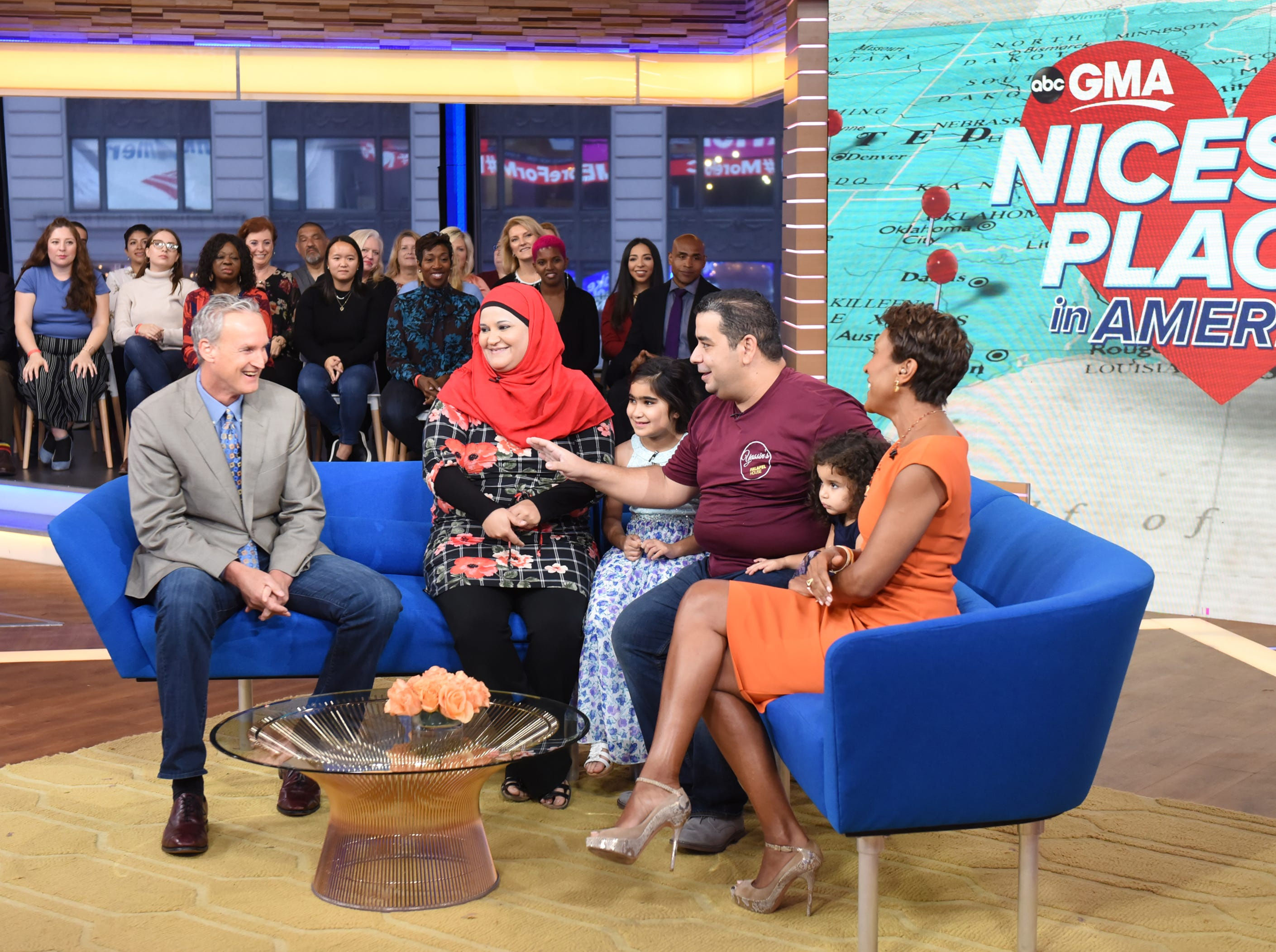 """Yassin Terou, owner of Yassin's Falafel House in Knoxville, Tenn., which was rated the Nicest Place in America, and his family (center) are guests on """"Good Morning America,"""" on Thursday, October 11, 2018 on ABC. Pictured are Bruce Kelley (left), Terou and family, and GMA host Robin Roberts."""