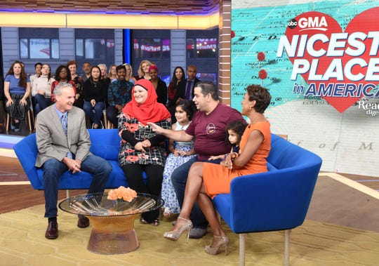 "Yassin Terou, owner of Yassin's Falafel House in Knoxville, Tenn., which was rated the Nicest Place in America, and his family (center) are guests on ""Good Morning America,"" on Thursday, October 11, 2018 on ABC. Pictured are Bruce Kelley (left), Terou and family, and GMA host Robin Roberts."