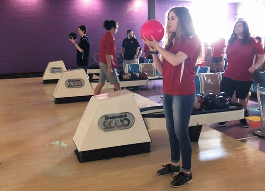 """Senior Grace Turner said she joined the Halls bowling team for extra PE credit. """"I thought it would be fun and I really like it,"""" she said."""