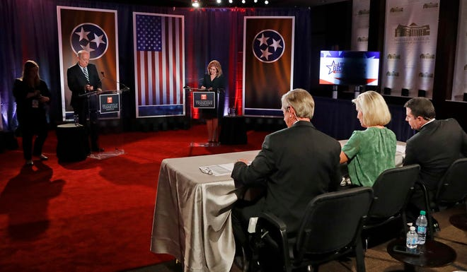 Democratic candidate and former Gov. Phil Bredesen and Republican U.S. Rep. Marsha Blackburn wait with the moderators for the start of the Tennessee U.S. Senate debate at the University of Tennessee, Wednesday, Oct. 10, 2018, in Knoxville, Tenn.