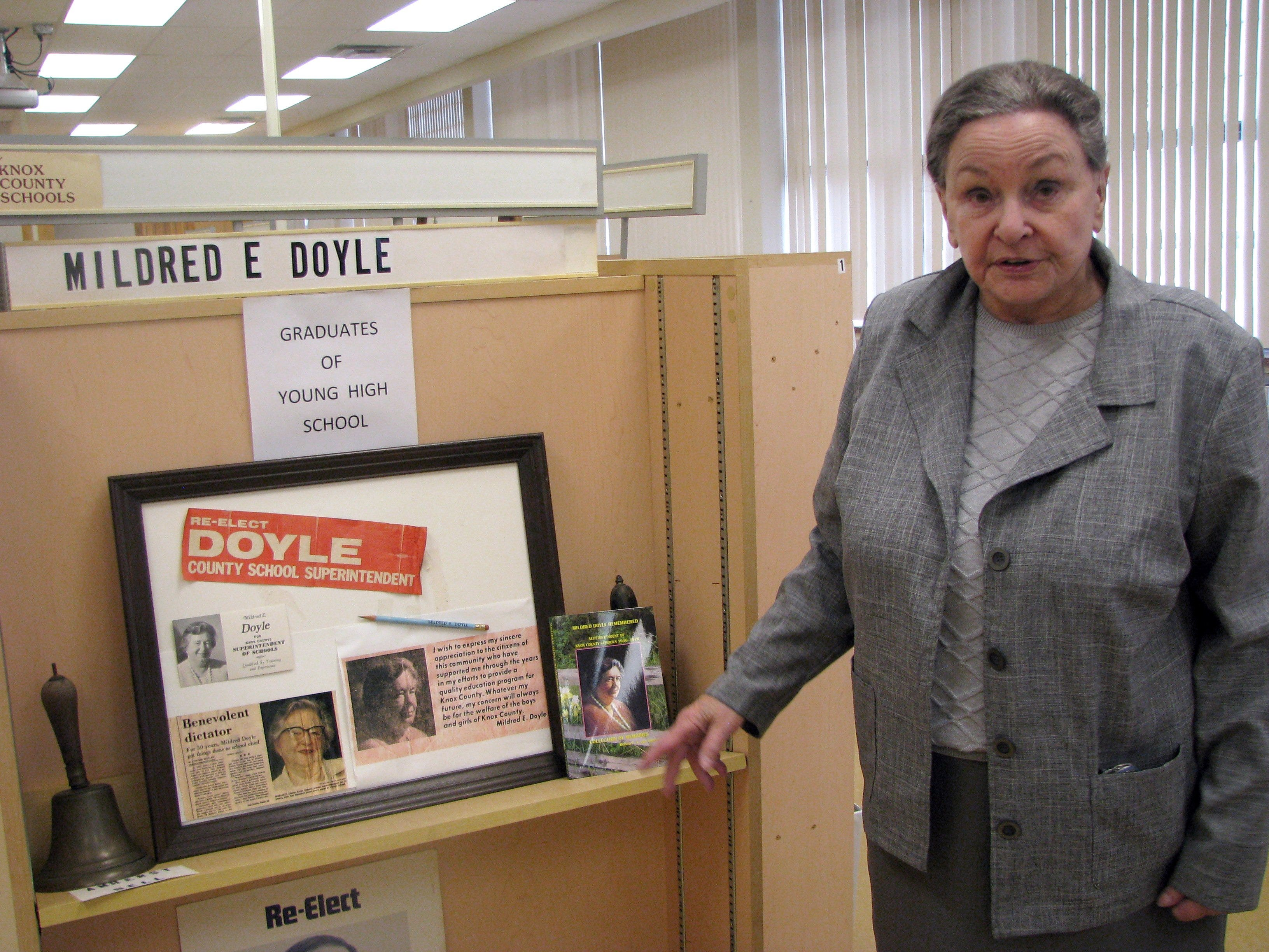 Knox County Museum of Education director Benna van Vuuren points out a display on Young High School graduate Mildred E. Doyle, who was Knox County's longest elected superintendent of schools, serving 1946-76. Van Vuuren wrote a biography on Doyle.