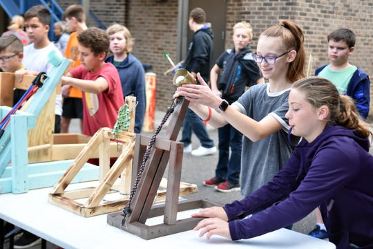 Students at South Doyle Middle launch catapults during a class exercise.