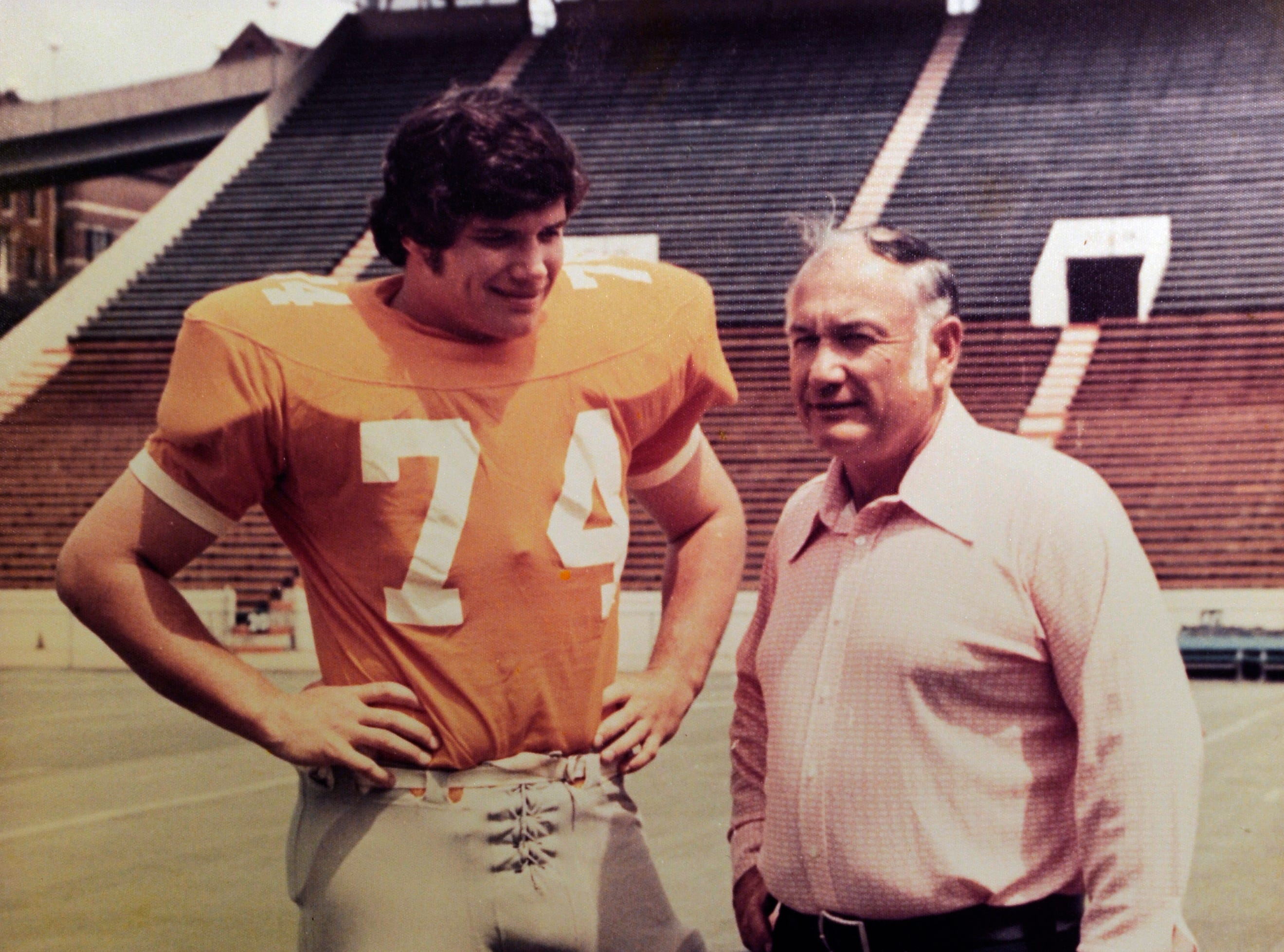 Family photograph of Bill Clabo, who was a Young High School football coach for years, and his son Phil Clabo in 1974 when he played for his dad at Young High School. On Sept. 25, Duff Park in South Knoxville is being renamed in Clabo's honor.