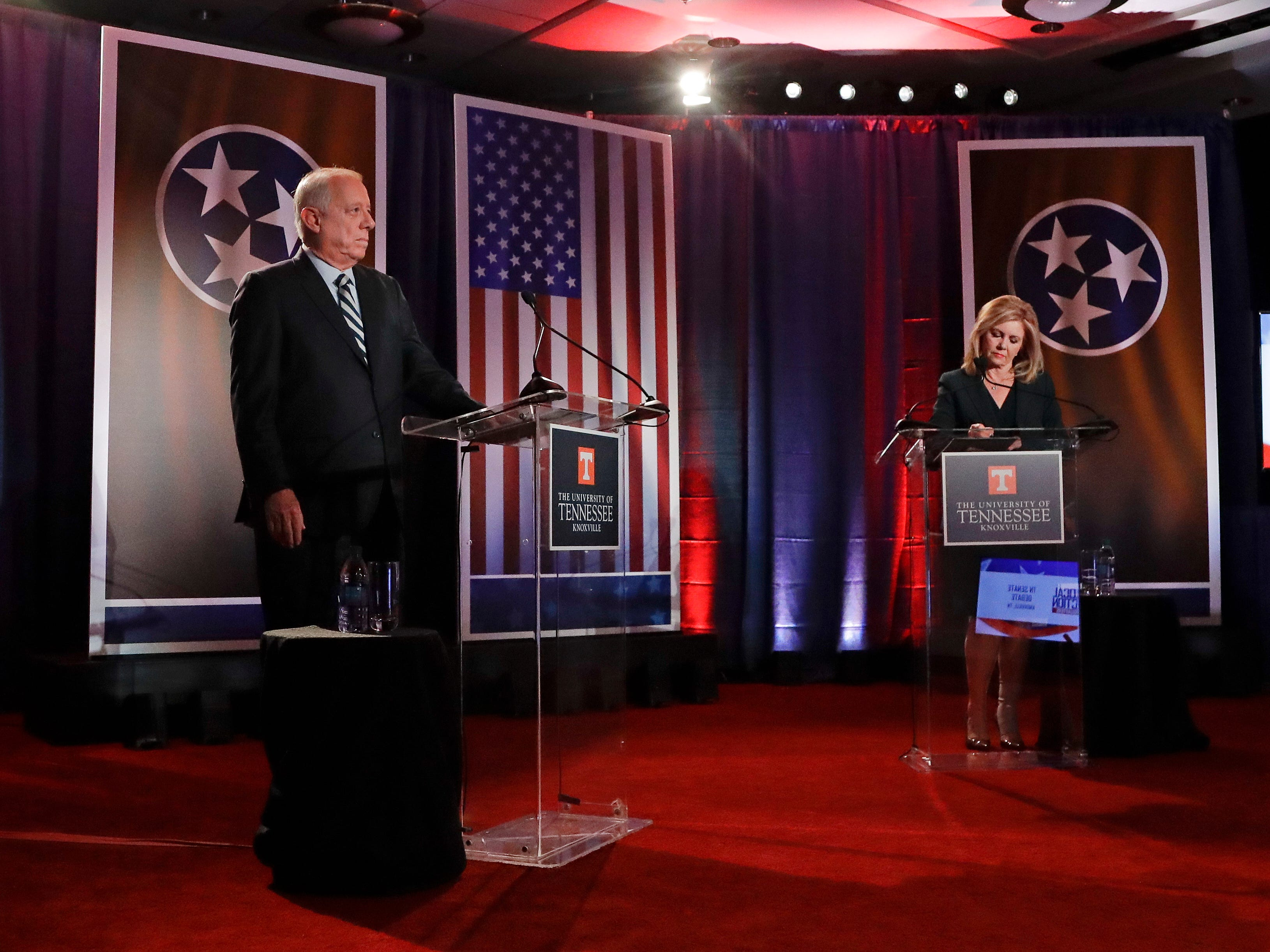 Democratic candidate and former Gov. Phil Bredesen, left, and Republican U.S. Rep. Marsha Blackburn wait for the start of the Tennessee U.S. Senate debate at The University of Tennessee, Wednesday, Oct. 10, 2018, in Knoxville, Tenn.