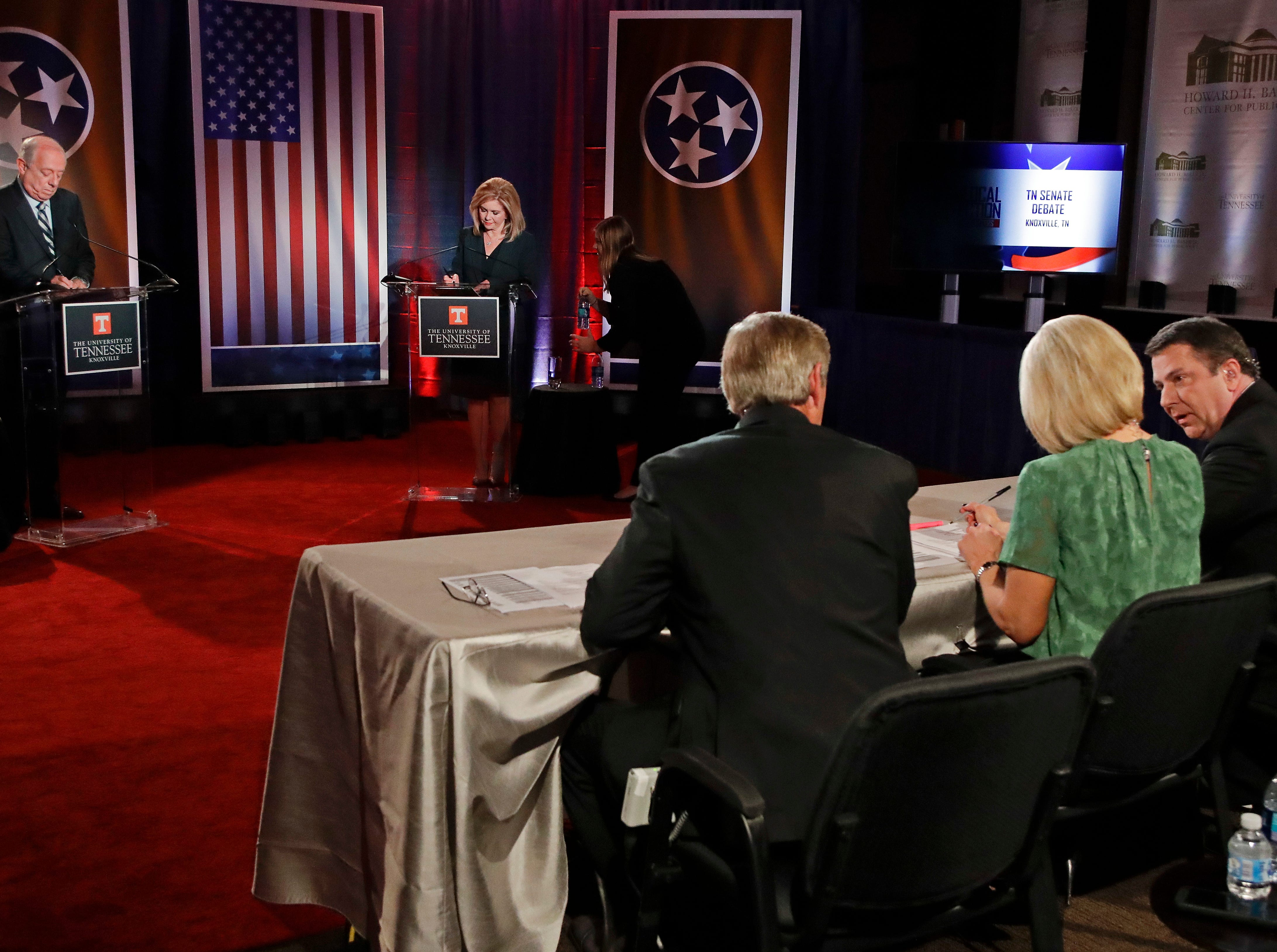 Democratic candidate and former Gov. Phil Bredesen and Republican U.S. Rep. Marsha Blackburn wait with the moderators for the start of the Tennessee U.S. Senate debate at the University of Tennessee, Wednesday, Oct. 10, 2018, in in Knoxville, Tenn.