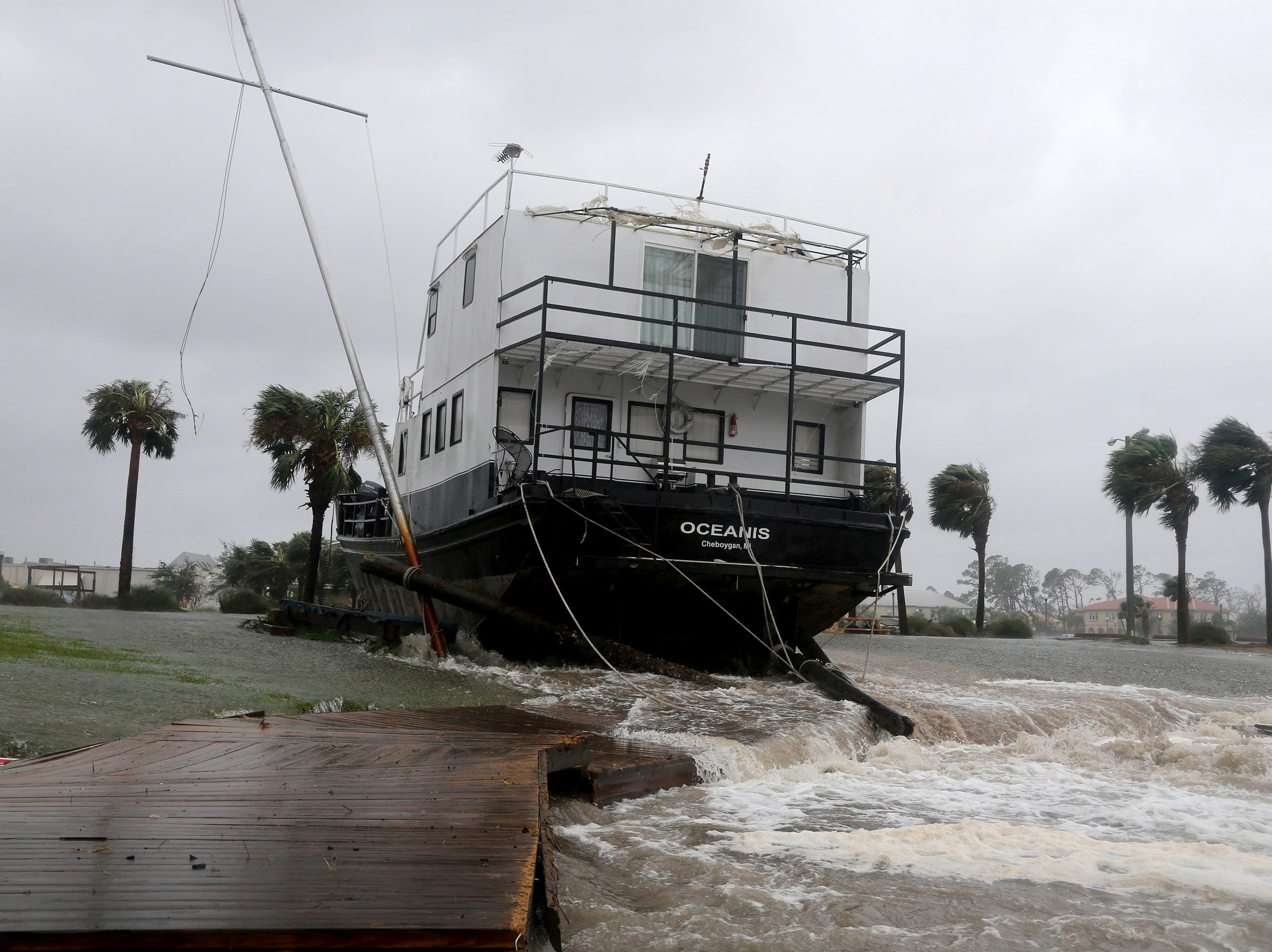 The Oceanis is grounded by a tidal surge at the Port St. Joe Marina, Wednesday, Oct. 10, 2018 in Port St. Joe, Fla. Supercharged by abnormally warm waters in the Gulf of Mexico, Hurricane Michael slammed into the Florida Panhandle with terrifying winds of 155 mph Wednesday, splintering homes and submerging neighborhoods.