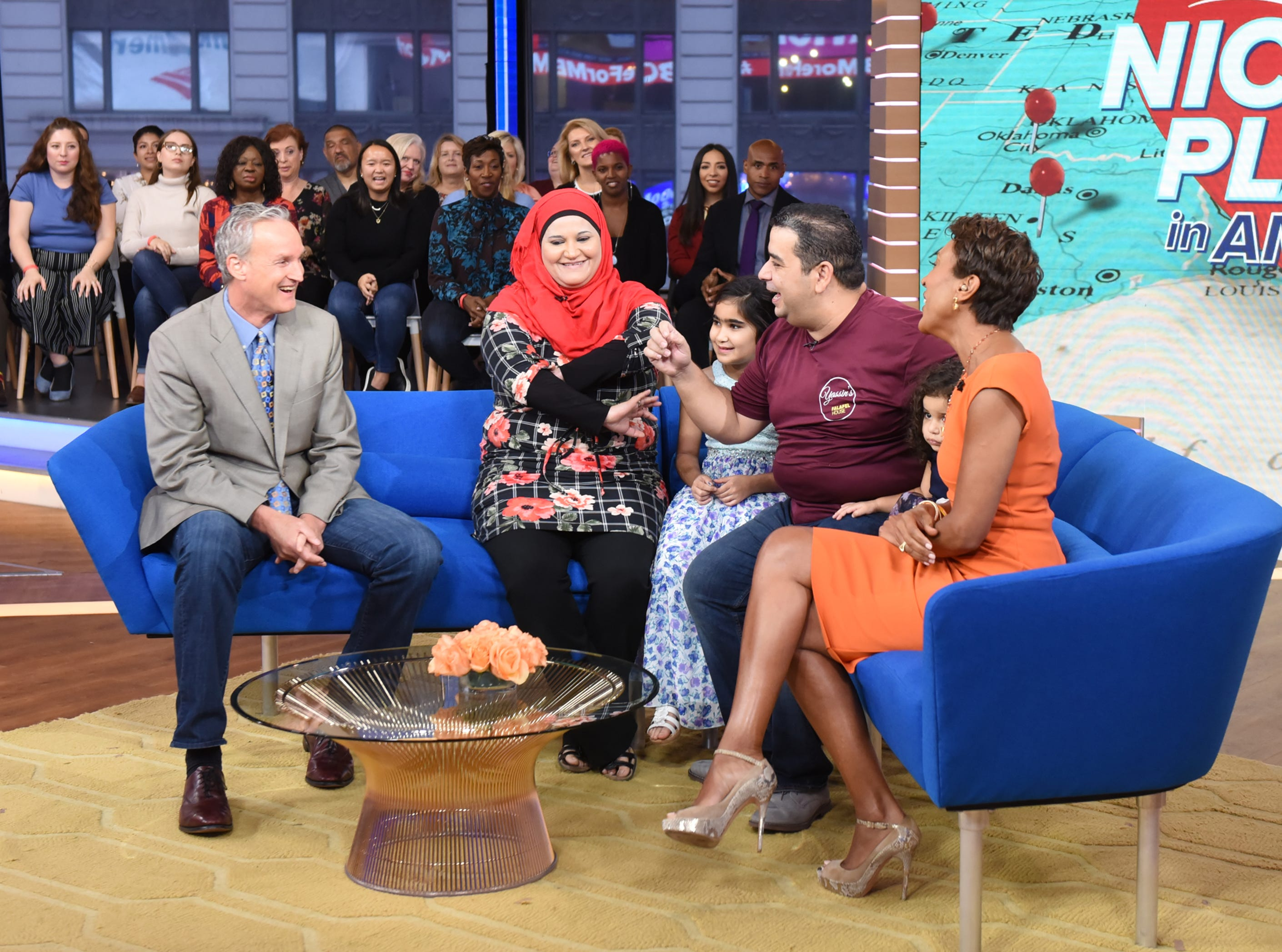 """Yassin Terou, owner of Yassin's Falafel House in Knoxville, Tenn., which was named the Nicest Place in America, is a guest on """"Good Morning America,"""" airing Thursday, October 11, 2018 on ABC. Pictured are Bruce Kelley (left), Yassin Terou and his family, and GMA host Robin Roberts."""