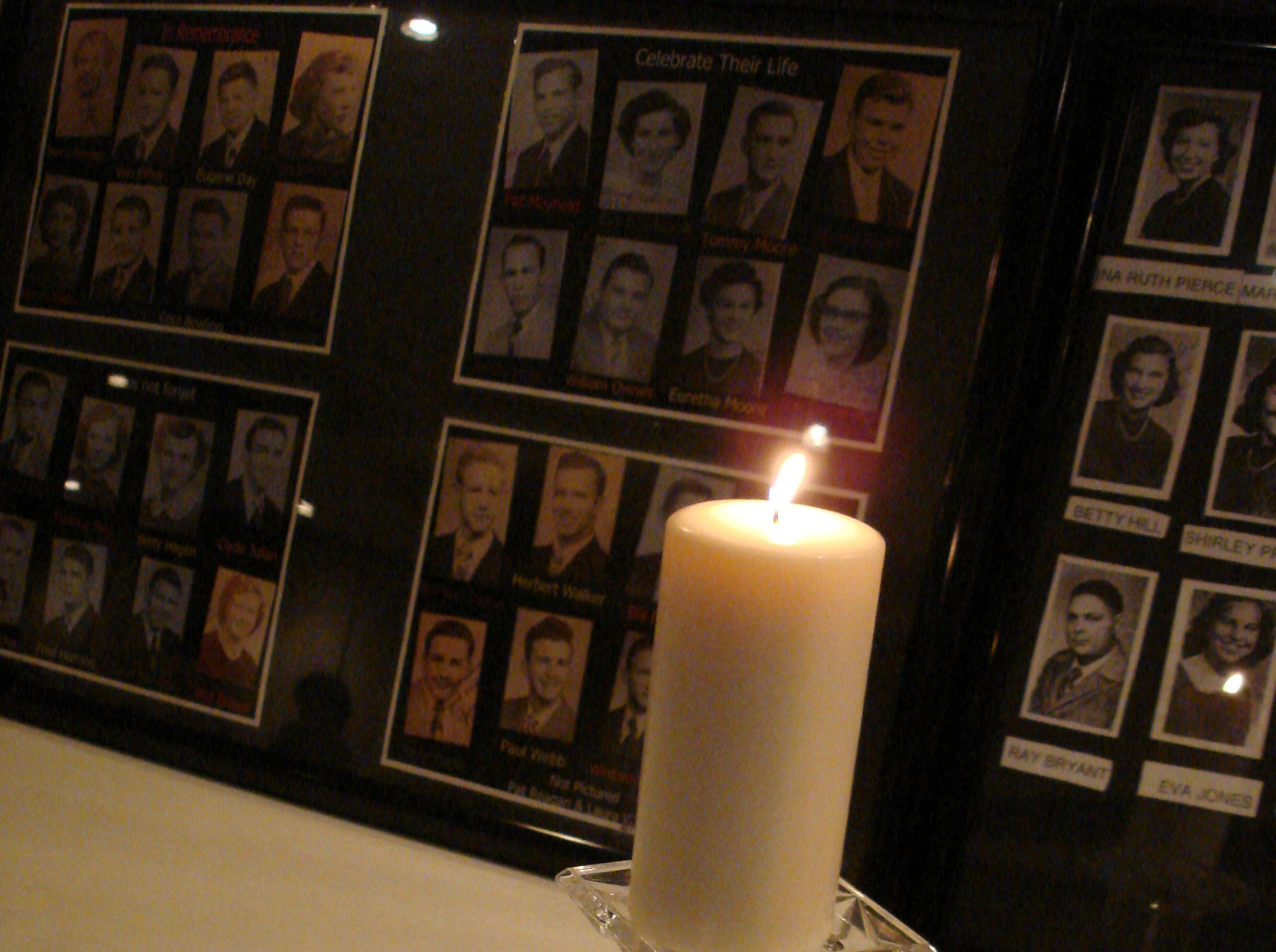 A single candle burns in memory of the 45 deceased members of the Young High School class of 1952.
