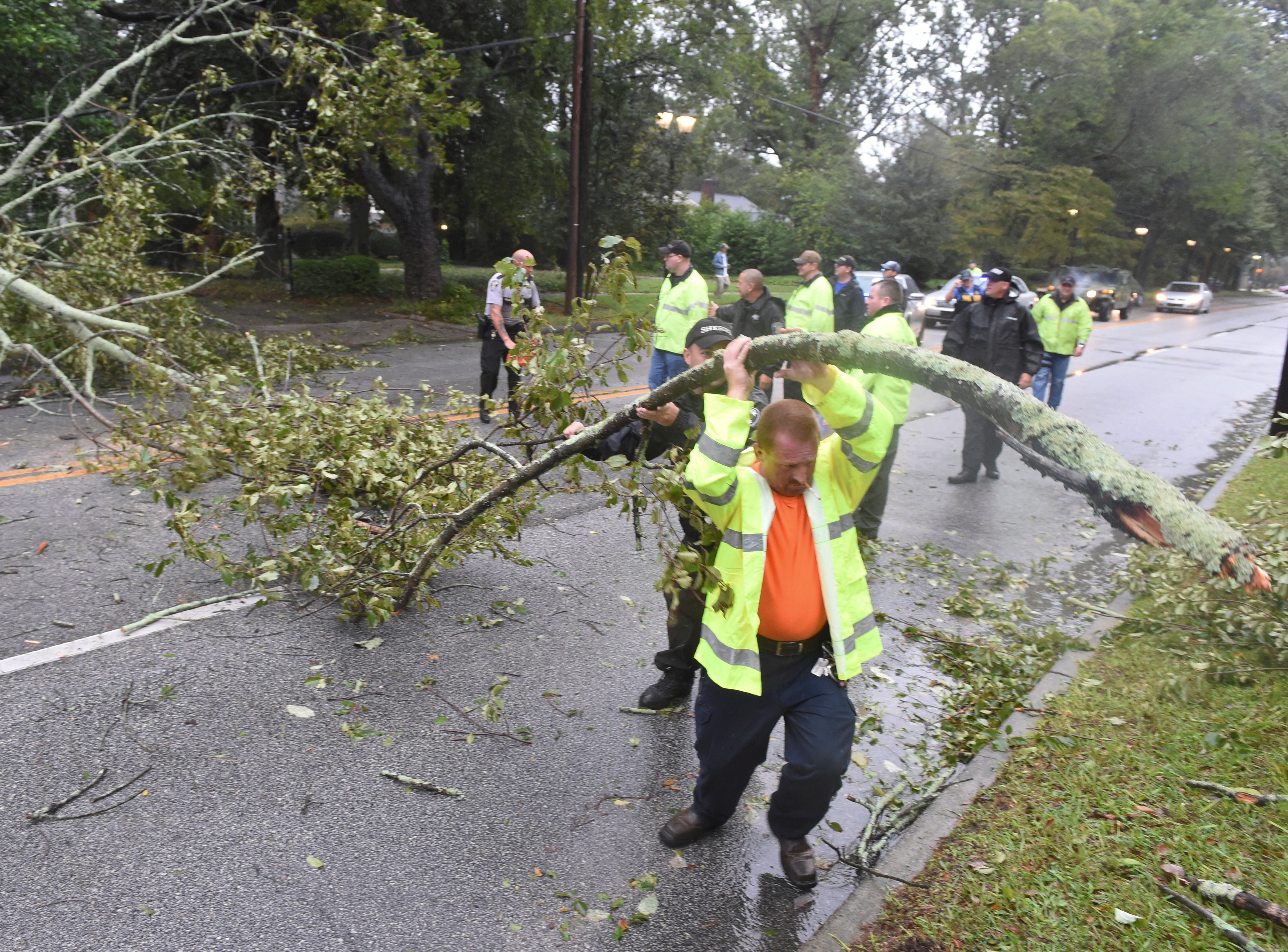 A crew works to remove a tree blocking Walton Way in Augusta, Ga. Thursday, Oct. 11, 2018, after it was blown down by tropical Storm Michael.