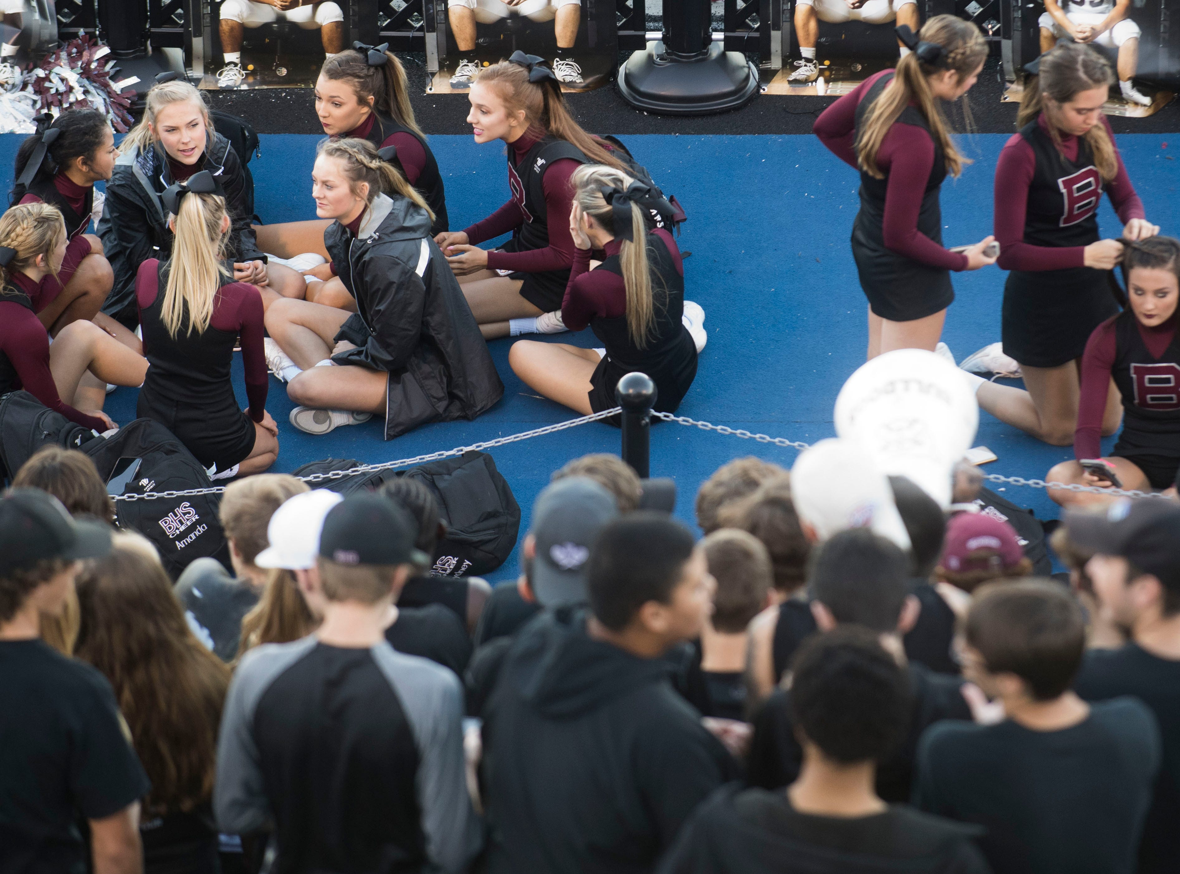 Bearden cheerleaders sit below the stands before a game between Bearden and Farragut at Bearden Thursday, Oct. 11, 2018.