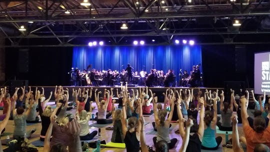 Over 80 yoga fans of all ages, shapes and abilities gathered at the Mill & Mine for an evening of yoga and classical music provided by the Knoxville Symphony Orchestra. October 4, 2018.