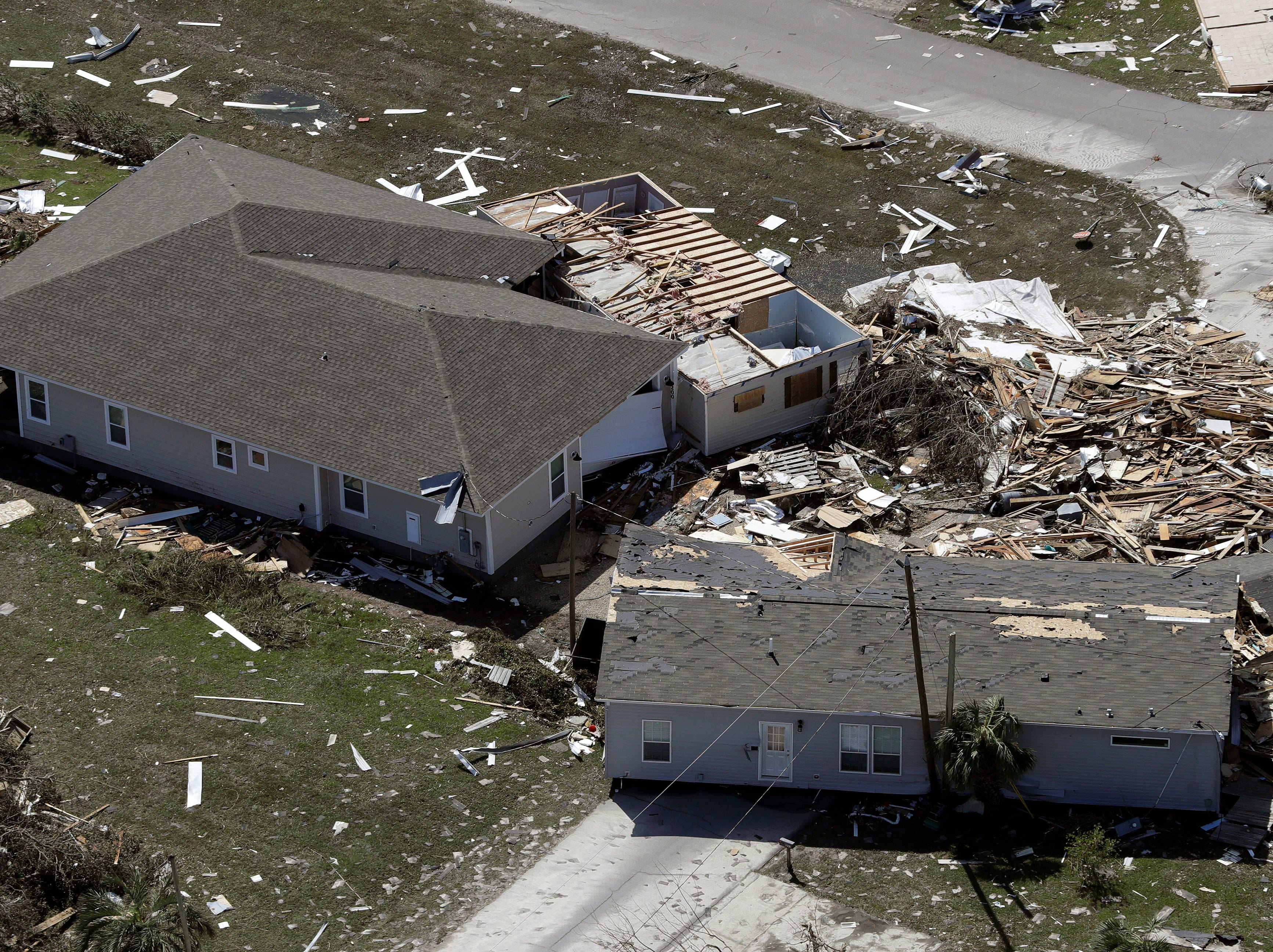 Debris from homes destroyed by Hurricane Michael litters the ground Thursday, Oct. 11, 2018, in Mexico Beach, Fla.