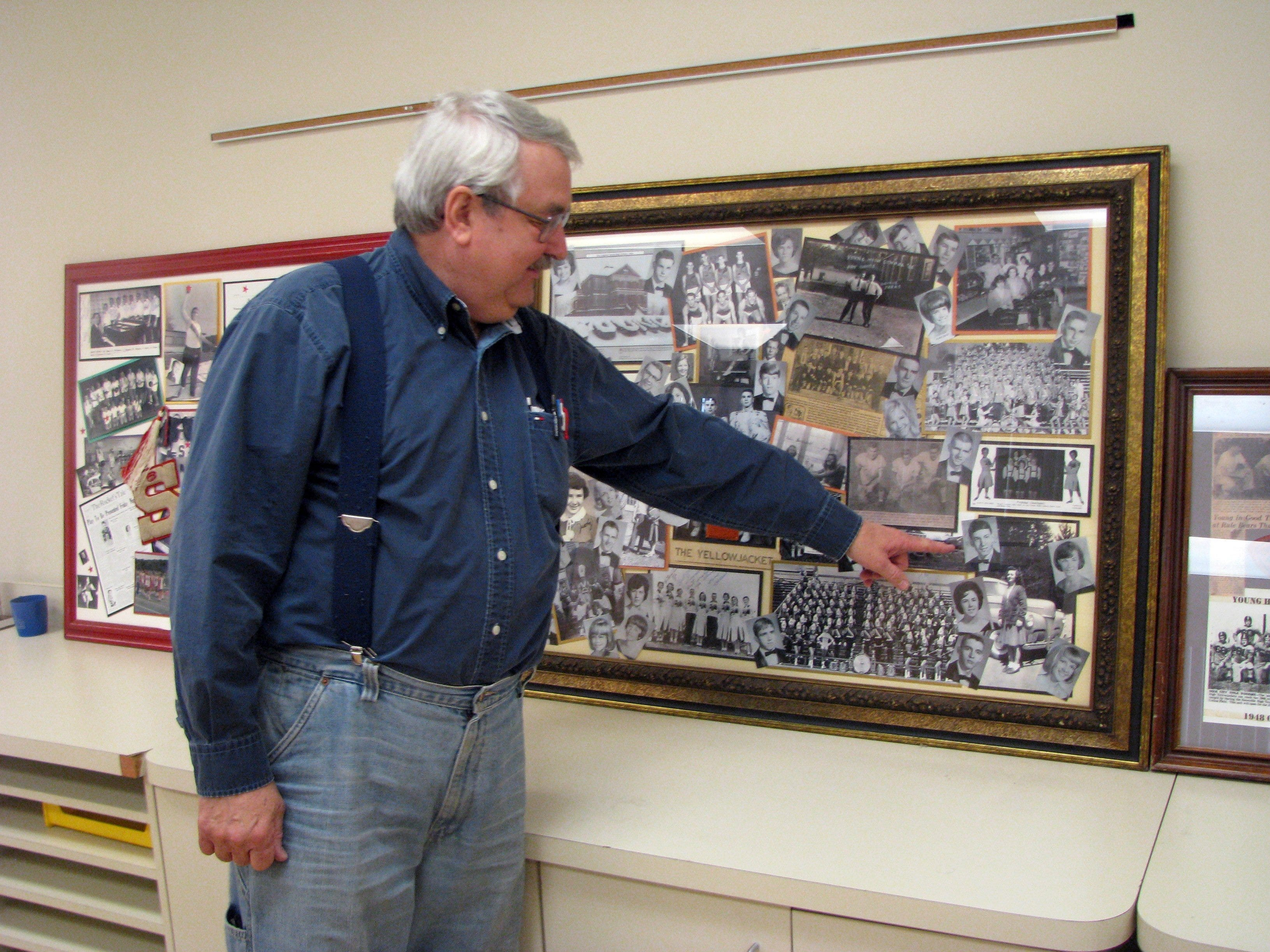 Knox County Museum of Education volunteer Jody Davis points out his senior picture in a display on Young High School. Young High School in South Knoxville existed 1912-1976.