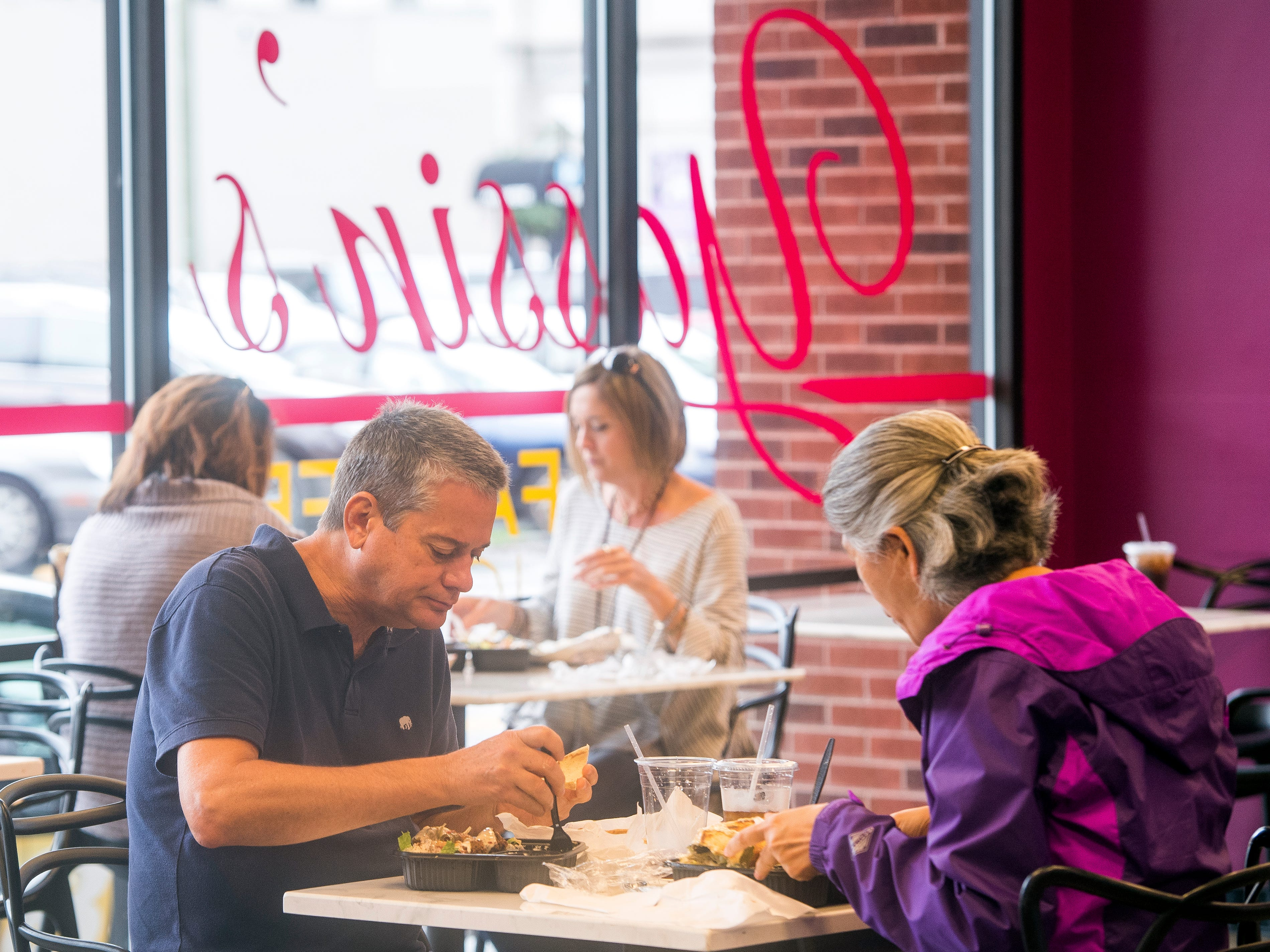"""Customers enjoy their lunch at Yassin's Falafel House in downtown Knoxville on Thursday, October 11, 2018. Yassin's Falafel House was named """"Nicest Place in America"""" by Reader's Digest."""