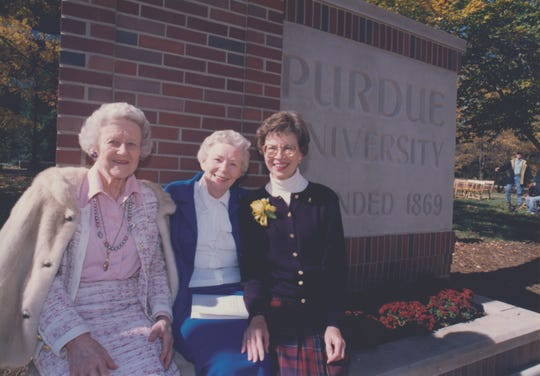 In this 1996 photo, former Purdue deans of students, from left, Beverley Stone, Barbara Cook and Betty Nelson gathered near the intersection of Northwestern Avenue and Grant Street for the  dedication of an entrance marker to Purdue University. The sign, in honor of Nelson, was the third entrance markers dedicated to the deans of students.
