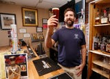 Co-owner David Thieme hoist a glass of Thieme & Wagner Bock Beer at Thieme & Wagner Brewery Wednesday, October 10, 2018, at 652 Main Street in Lafayette.